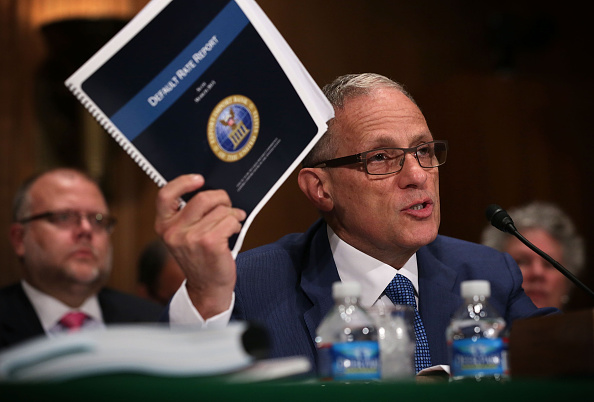 Fred Hochberg, Chairman and President of the Export-Import Bank of the United States holds up a copy of the bank's Default Rate Report as he testifies during a hearing before the Senate Banking, Housing and Urban Affairs Committee June 4, 2015 on Capitol Hill in Washington, D.C.