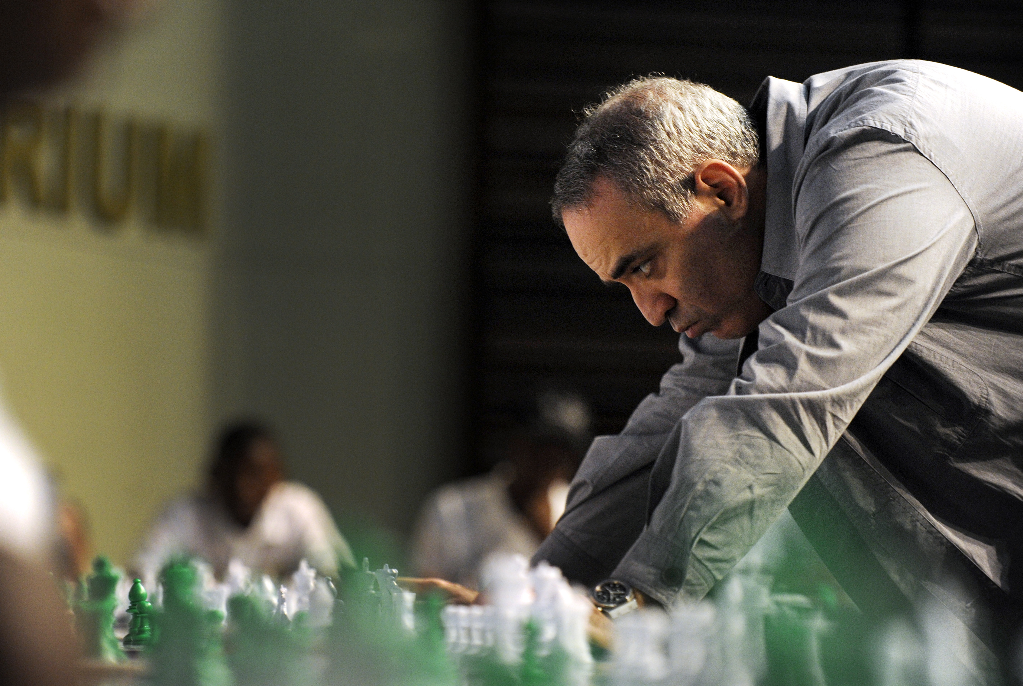 Former World Chess Champion Garry Kasparov plays a game of chess with school children on March 25, 2012 in Pretoria, South Africa.
