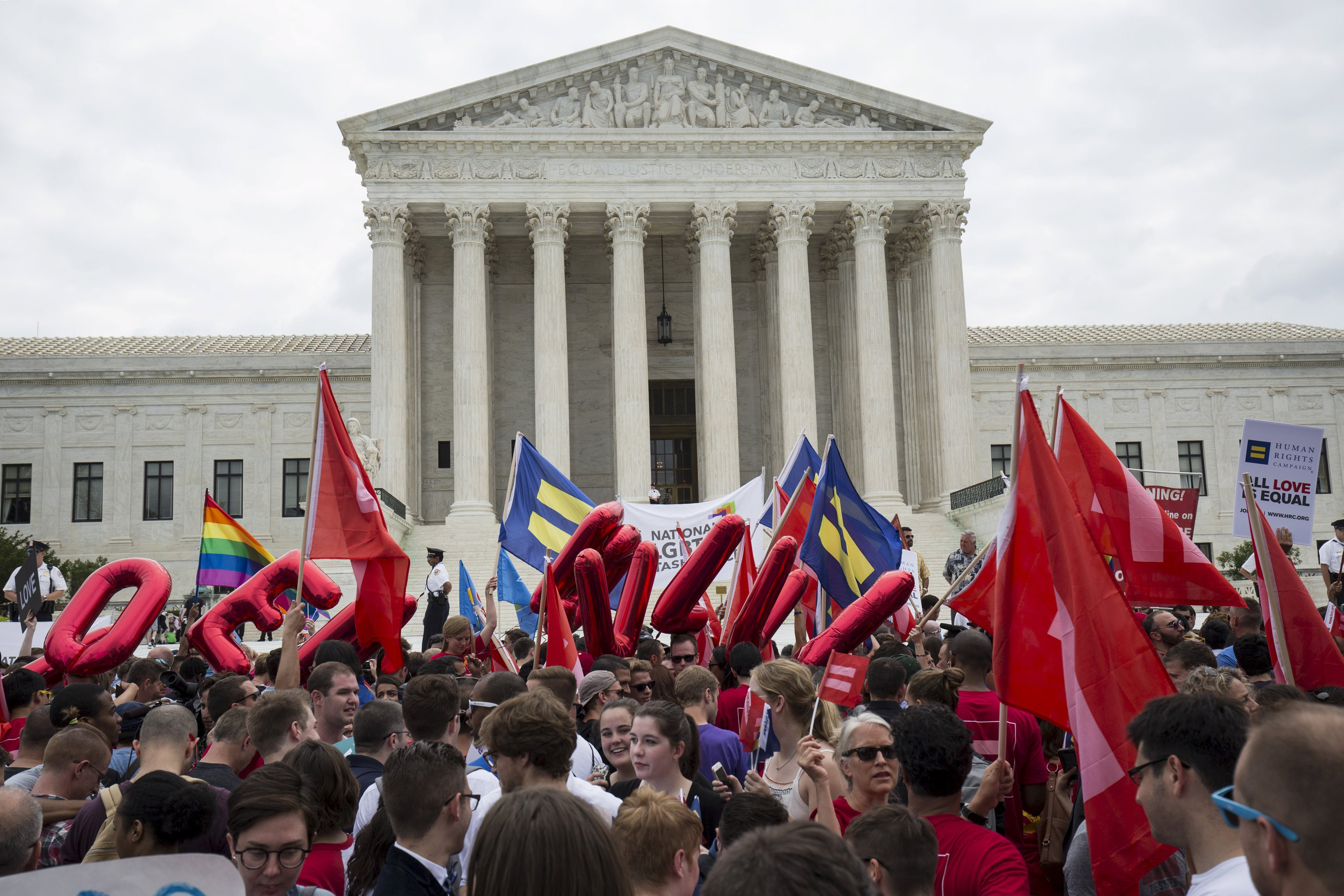Supporters of gay marriage rally after the U.S. Supreme Court ruled on Friday that the U.S. Constitution provides same-sex couples the right to marry at the Supreme Court in Washington June 26, 2015.