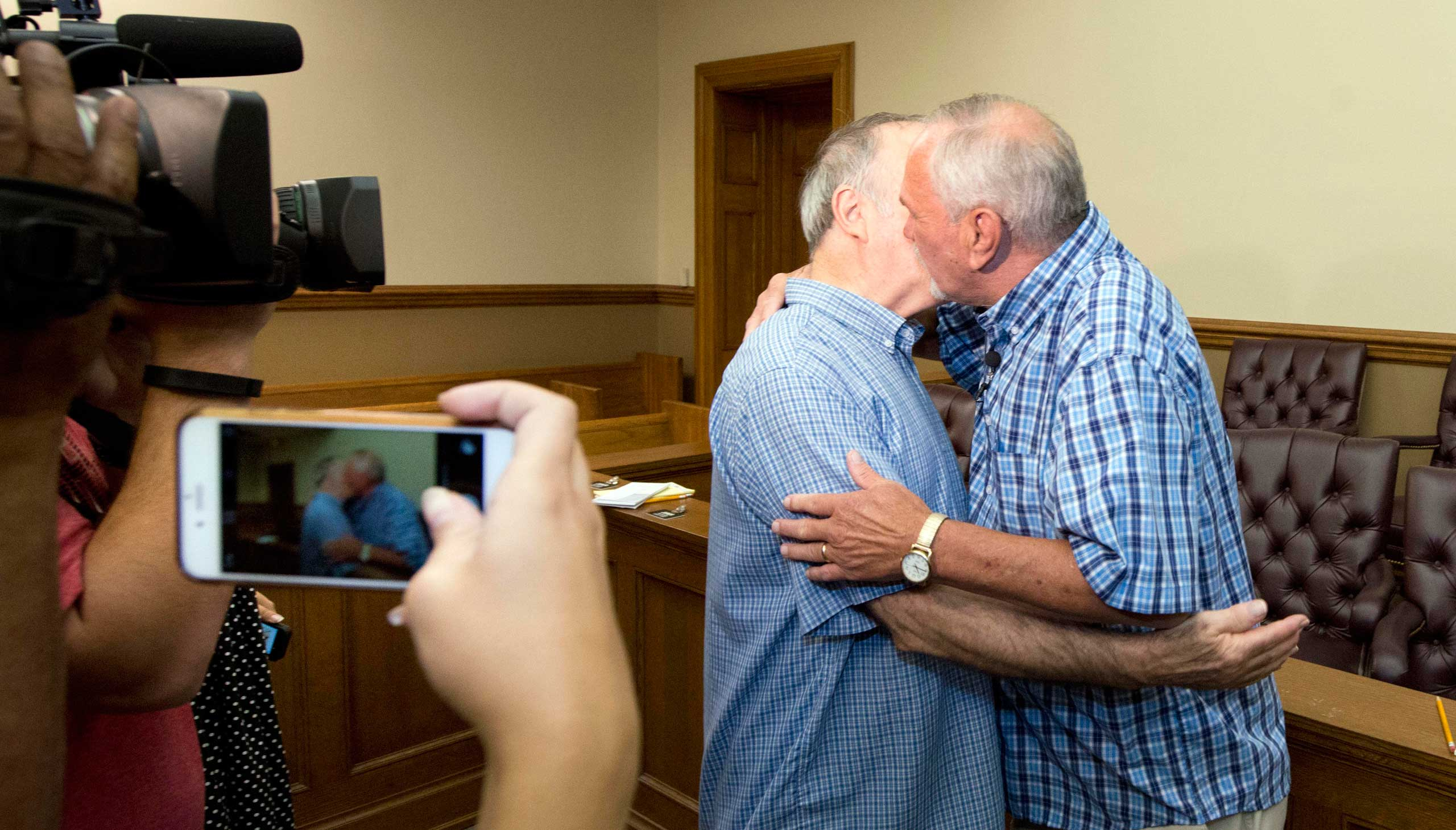 Tony Chiaro, left, and Earnie Matheson, right, embrace after exchanging vows in the first same sex marriage performed in Pulaski County, in Little Rock, Ark. on June 26, 2015.