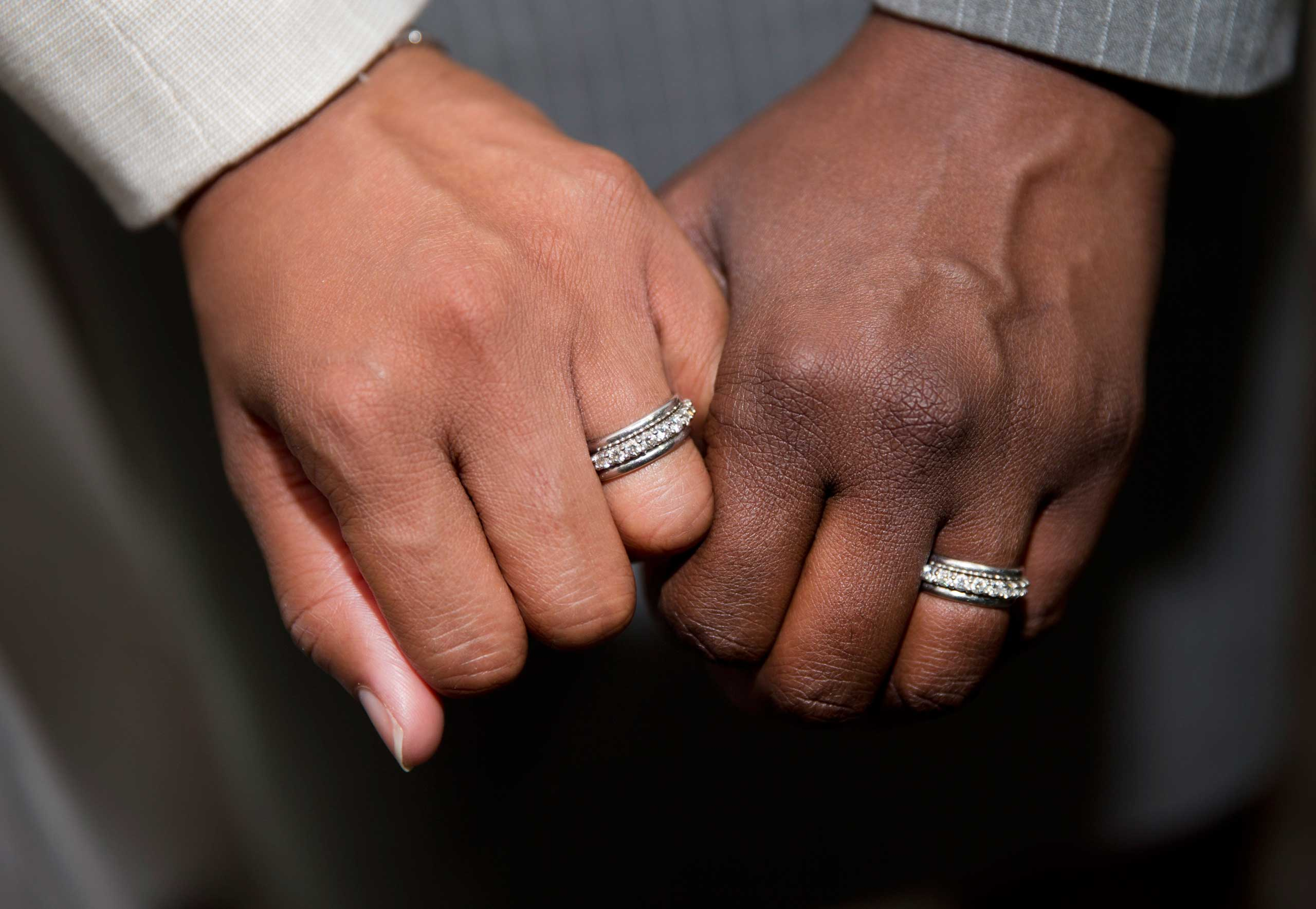 Emma Foulkes, left, and Petrina Bloodworth hold hands and show their wedding rings after being married at the Foulton County Courthouse in Atlanta on June 26, 2015.