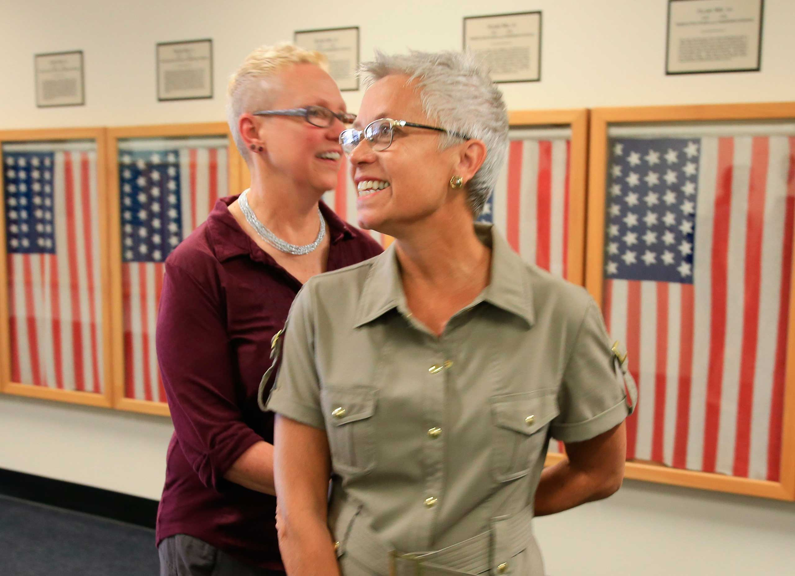 Beverly Reicks, right, and Kathy Petterson, the first same sex couple to wed in Omaha, Neb., leave the Douglas County Clerk's office on June 26, 2015.