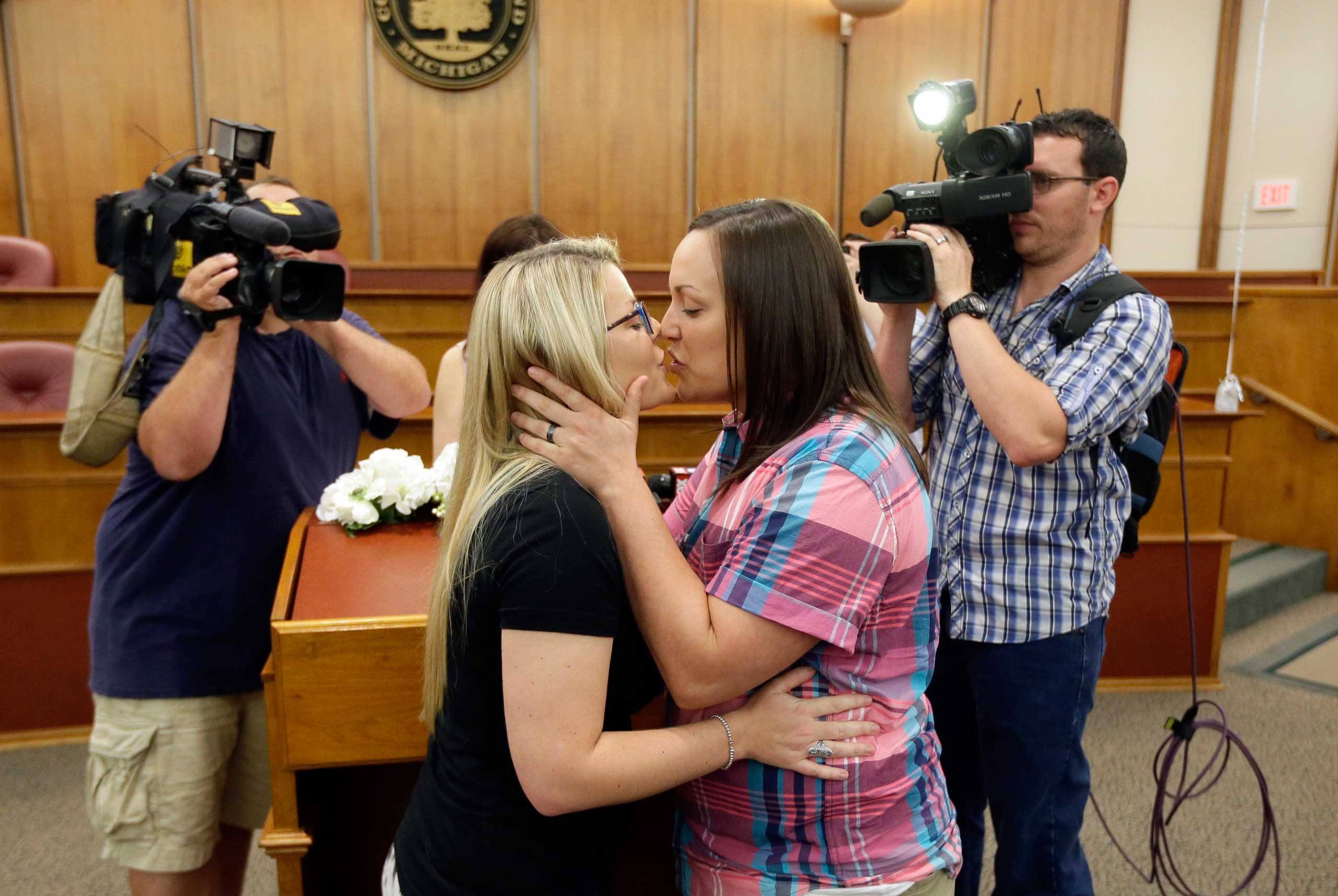 Breanne Brodak, left, and Cortney Tucker kiss after being married by Oakland County Clerk Lisa Brown in Pontiac, Mich. on June 26, 2015.