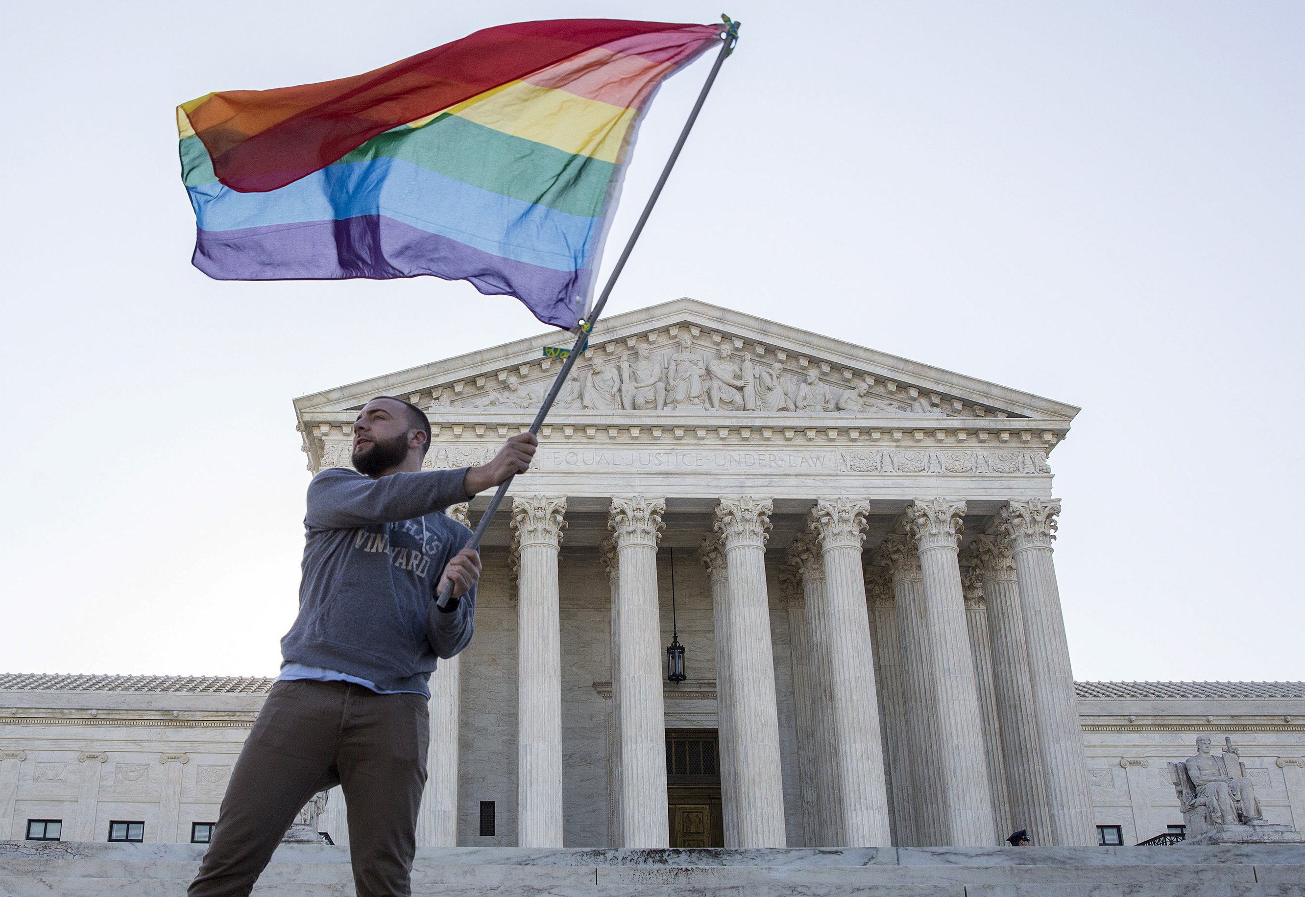 Vin Testa of Washington waves a gay-rights flag in front of the Supreme Court before a hearing about gay marriage in Washington on April 28, 2015