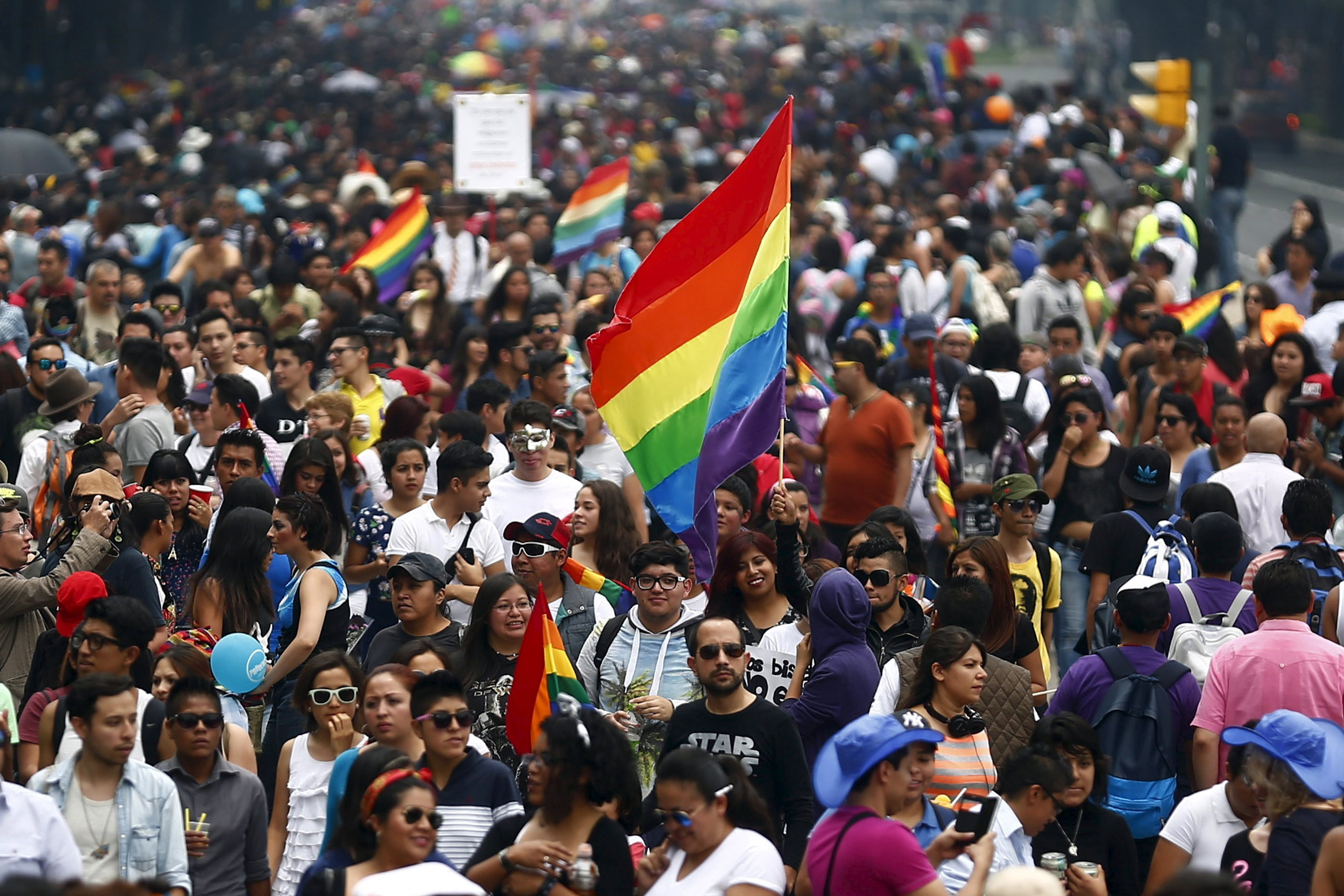 Participants march during a Gay Pride Parade in Mexico City on June 27, 2015.