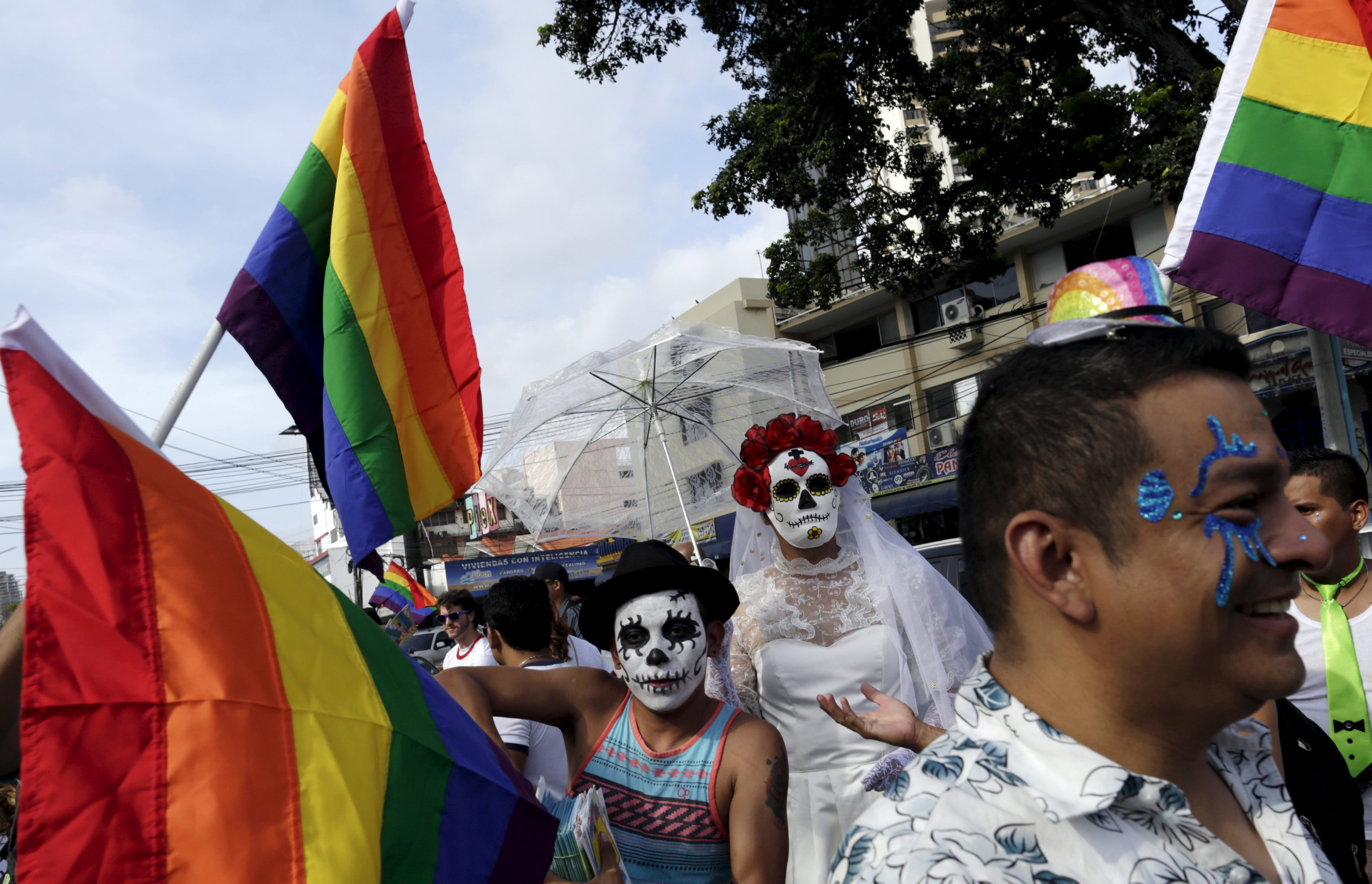 Revelers with skull masks take part in a Gay Pride parade in Panama City on June 27, 2015.