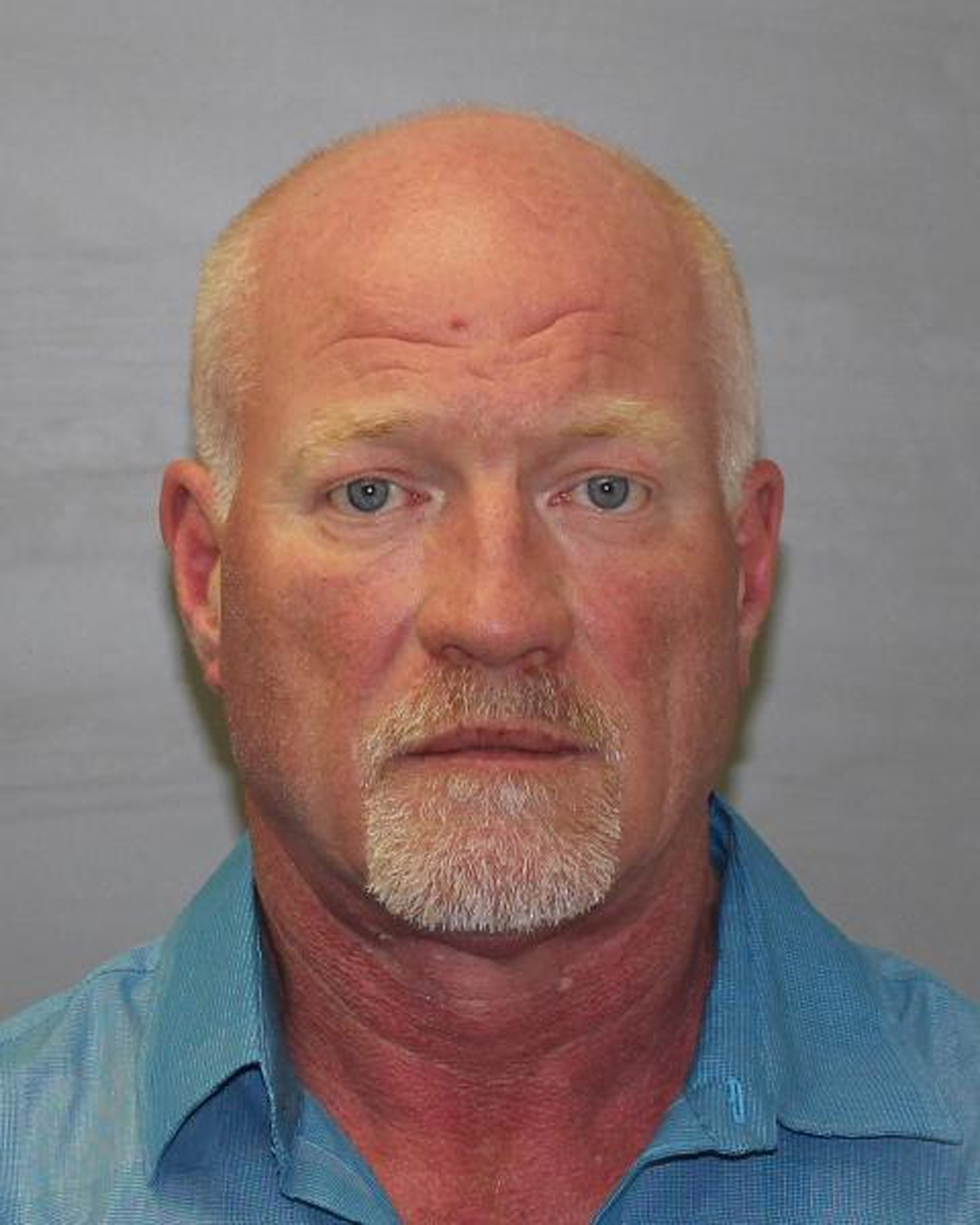 In this handout photo provided by the New York State Police, Clinton Correctional Facility Correction Officer Gene Palmer, 57, of Dannemora, NY poses for a mugshot photo, June 24, 2015.