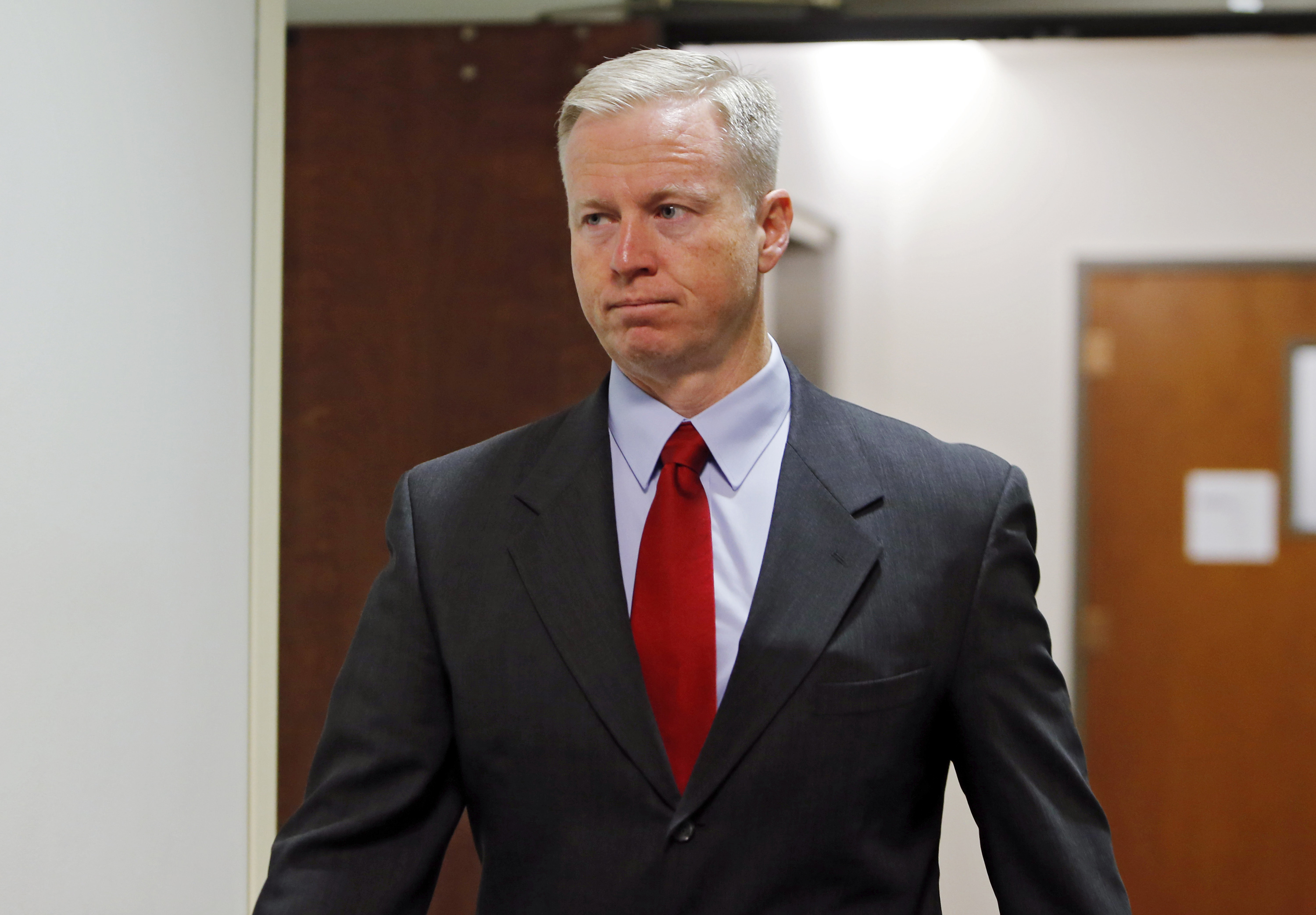 18th Judicial District Attorney George Brauchler arrives for a hearing for Aurora theater shooting suspect James Holmes at district court in Centennial, Colo. on Sept. 30, 2013.