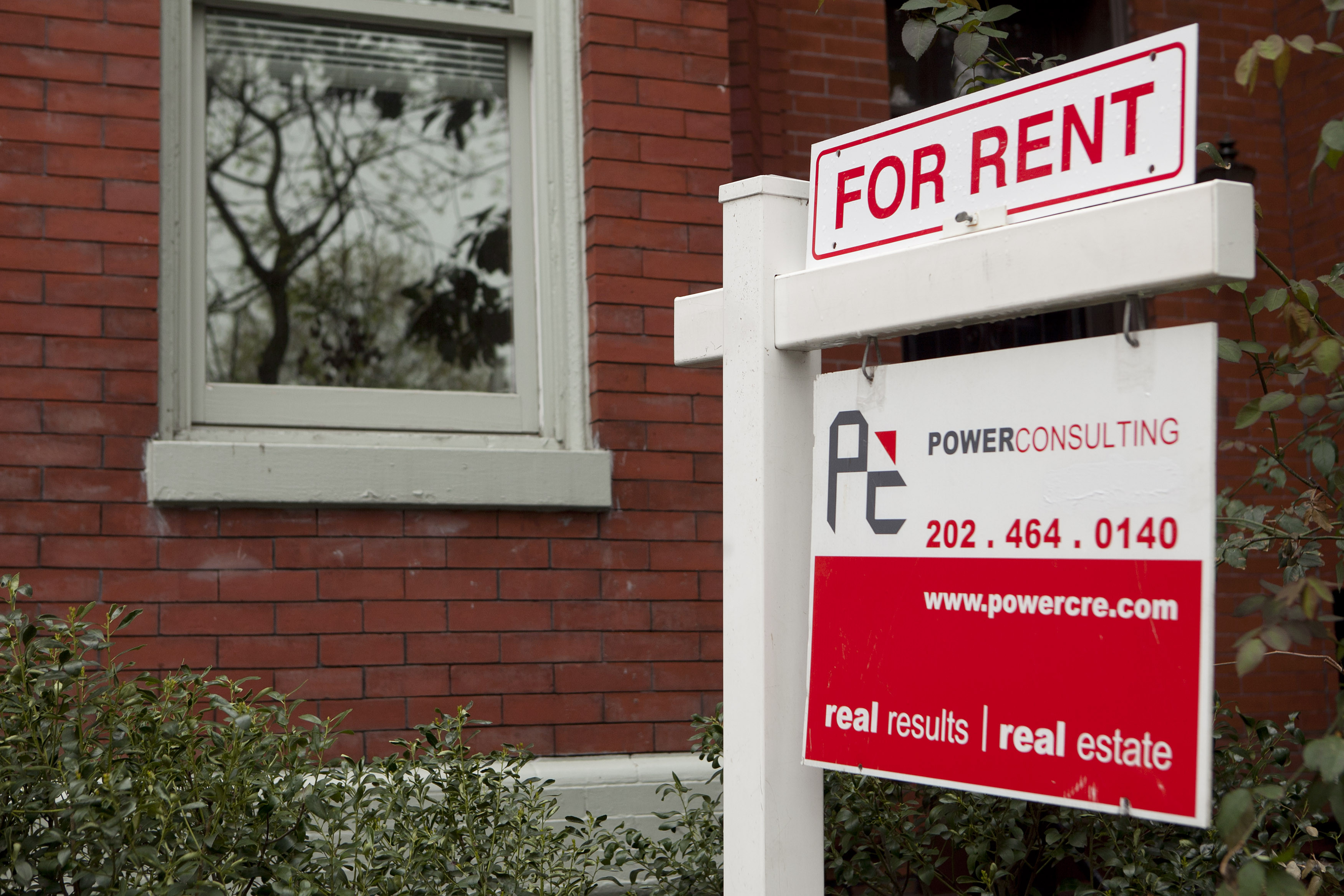 A for rent sign stands in front of a row house in the Logan Circle neighborhood of Washington, D.C.