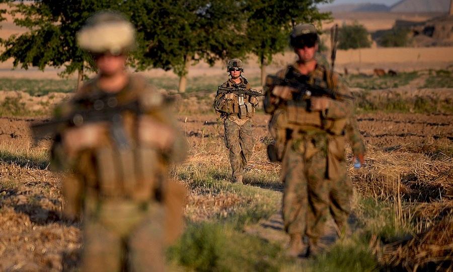 A female U.S. Marine on patrol in Afghanistan.