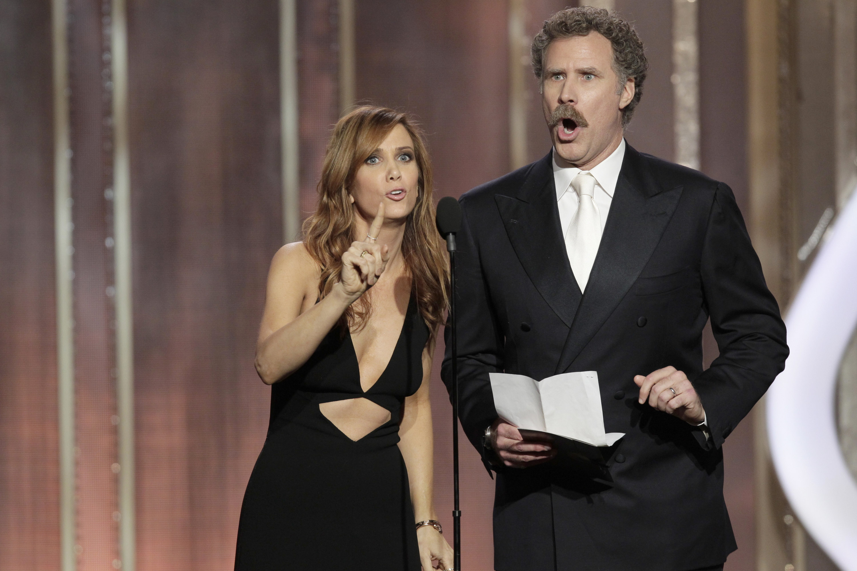 BEVERLY HILLS, CA - JANUARY 13: In this handout photo provided by NBCUniversal, Kristen Wiig and Will Ferrell on stage to present the Best Actress - Motion Picture, Comedy or Musical award during the 70th Annual Golden Globe Awards at the Beverly Hilton Hotel International Ballroom on January 13, 2013 in Beverly Hills, California. (Photo by Paul Drinkwater/NBCUniversal via Getty Images)