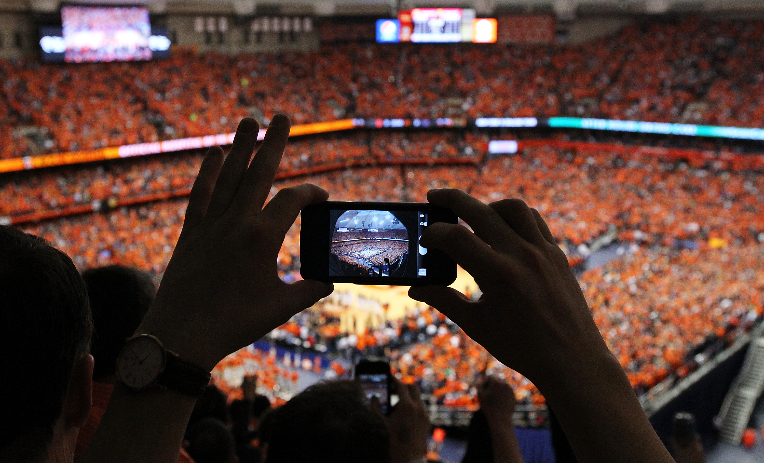 A general view of the Carrier Dome seen through a camera on an iPhone of a fan in the stands at the start of the game between the Syracuse Orange and the Georgetown Hoyas on February 23, 2013 in Syracuse, New York.