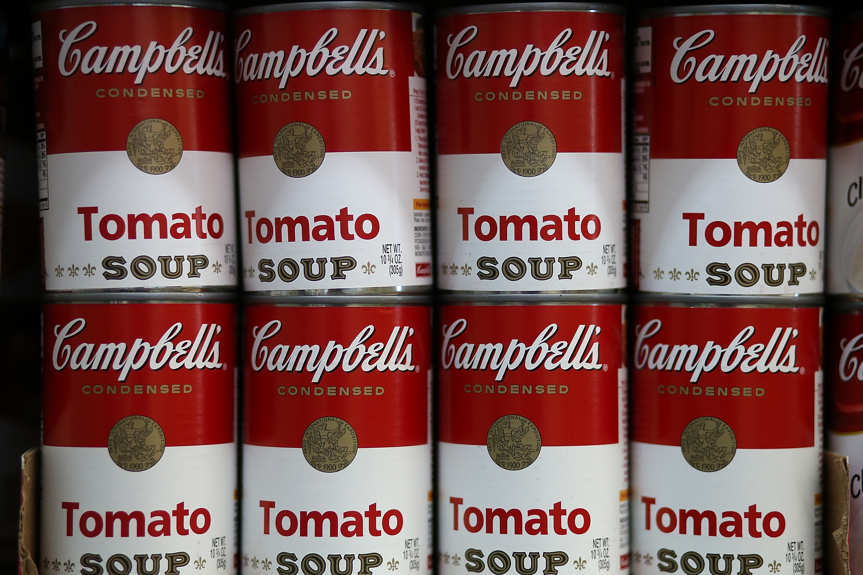 Cans of Campbell's tomato soup are displayed on a shelf at Santa Venetia Market on May 20, 2013 in San Rafael, California.