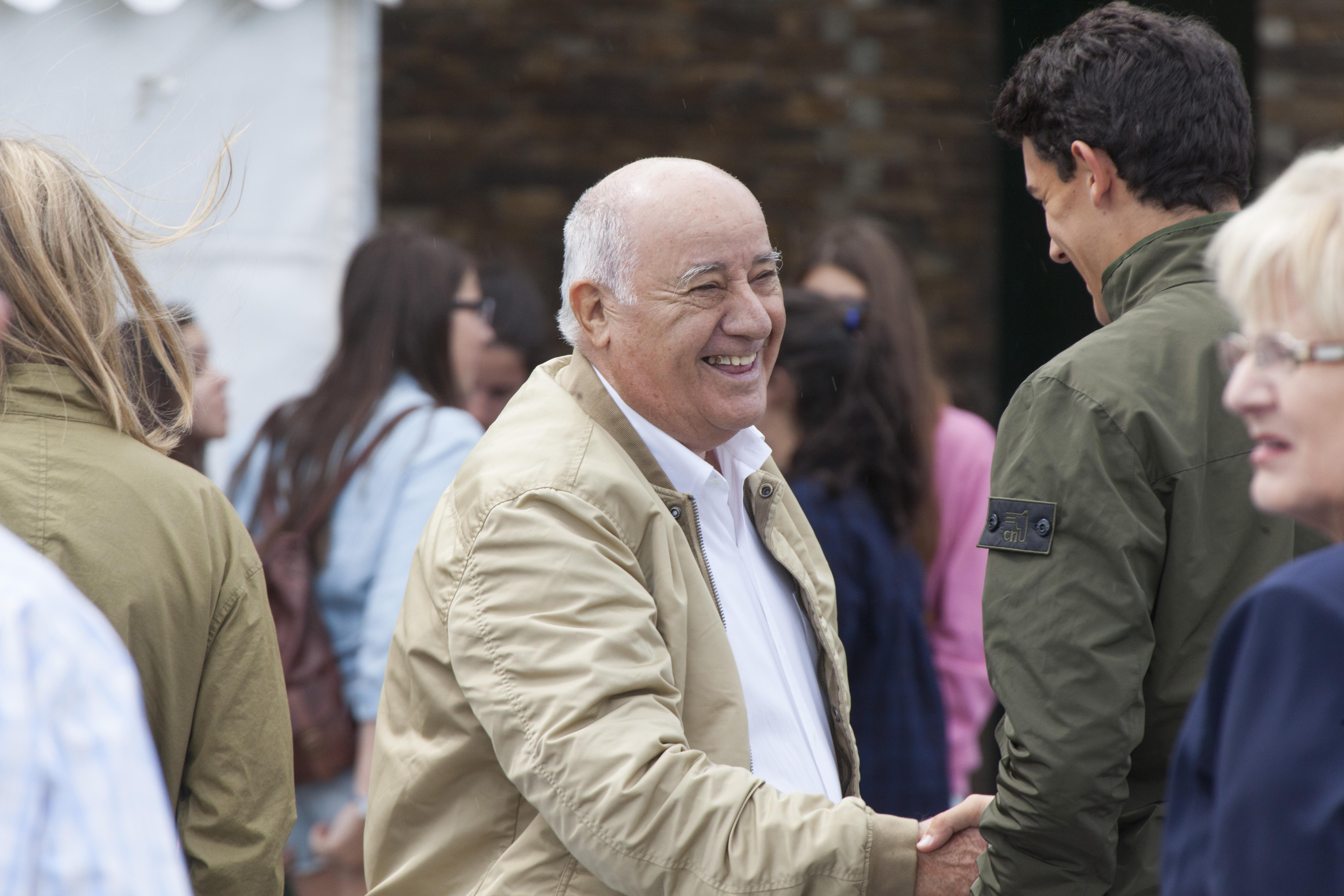 Amancio Ortega, owner of Zara empire, meets some friends at CSI Casas Novas Horse Jumping Competition 2013 near Arteixo on July 27, 2013 in A Coruna, Spain.