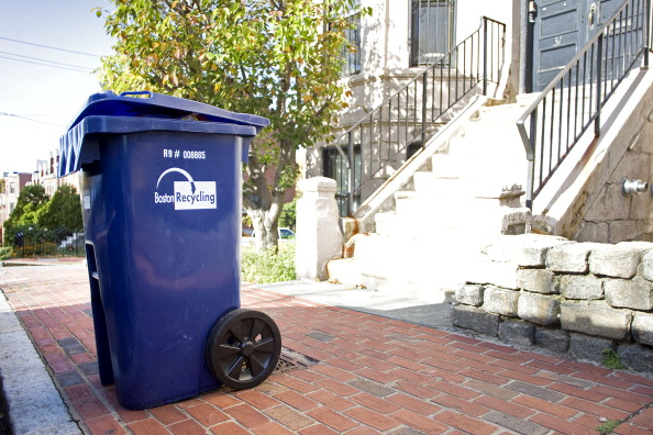 ROXBURY, MA - OCTOBER 26: A large blue bin is photographed on Fort Ave. in Roxbury, Mass. on Monday, October 26, 2009. Small blue recycle bins are being replaced by large blue bins that are harder to fit into the homes of people who live in small units. (Photo by Yoon S. Byun/The Boston Globe via Getty Images)