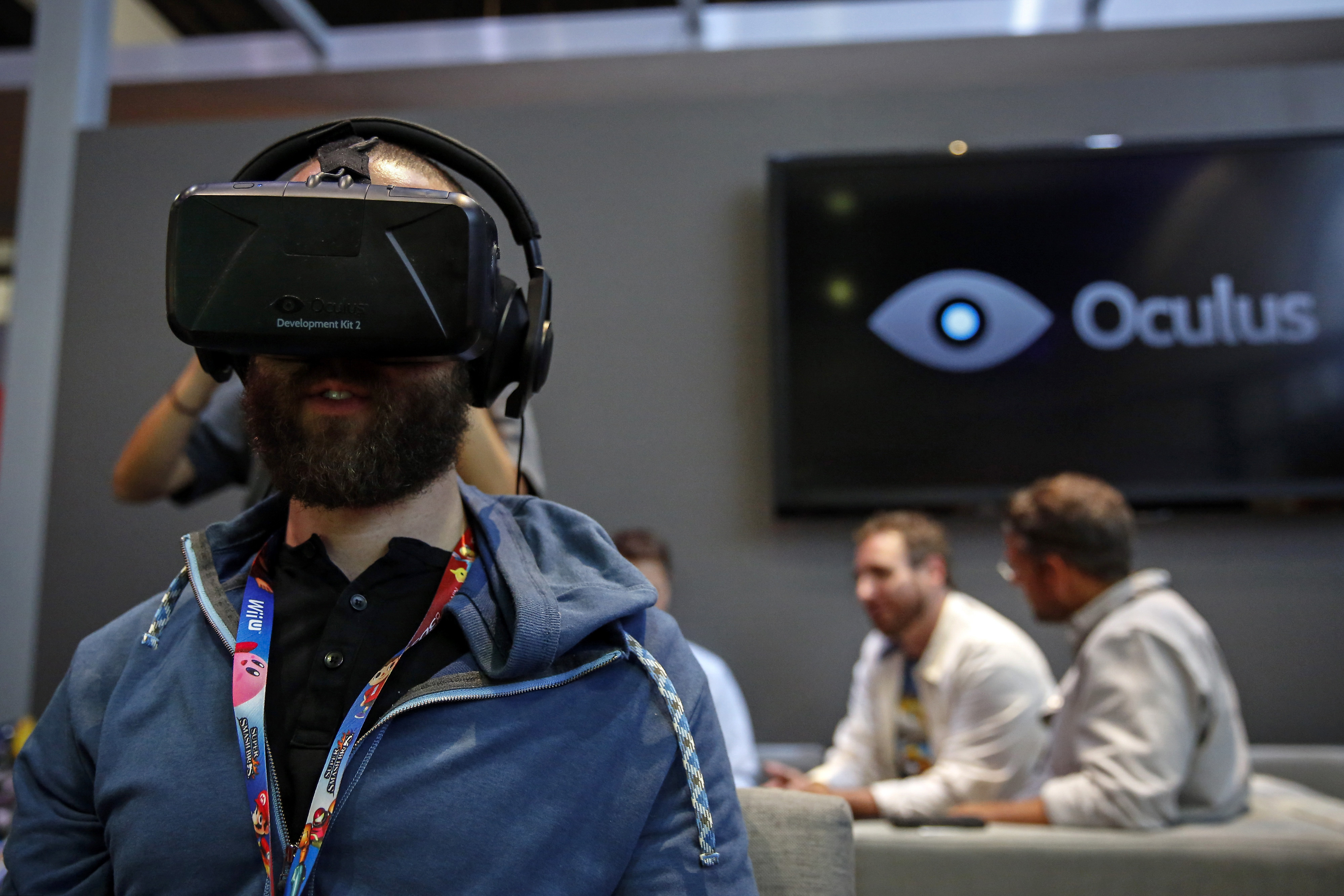 An attendee wears an Oculus VR Inc. Rift Development Kit 2 headset to play a video game during the E3 Electronic Entertainment Expo in Los Angeles, California, U.S., on Wednesday, June 11, 2014.