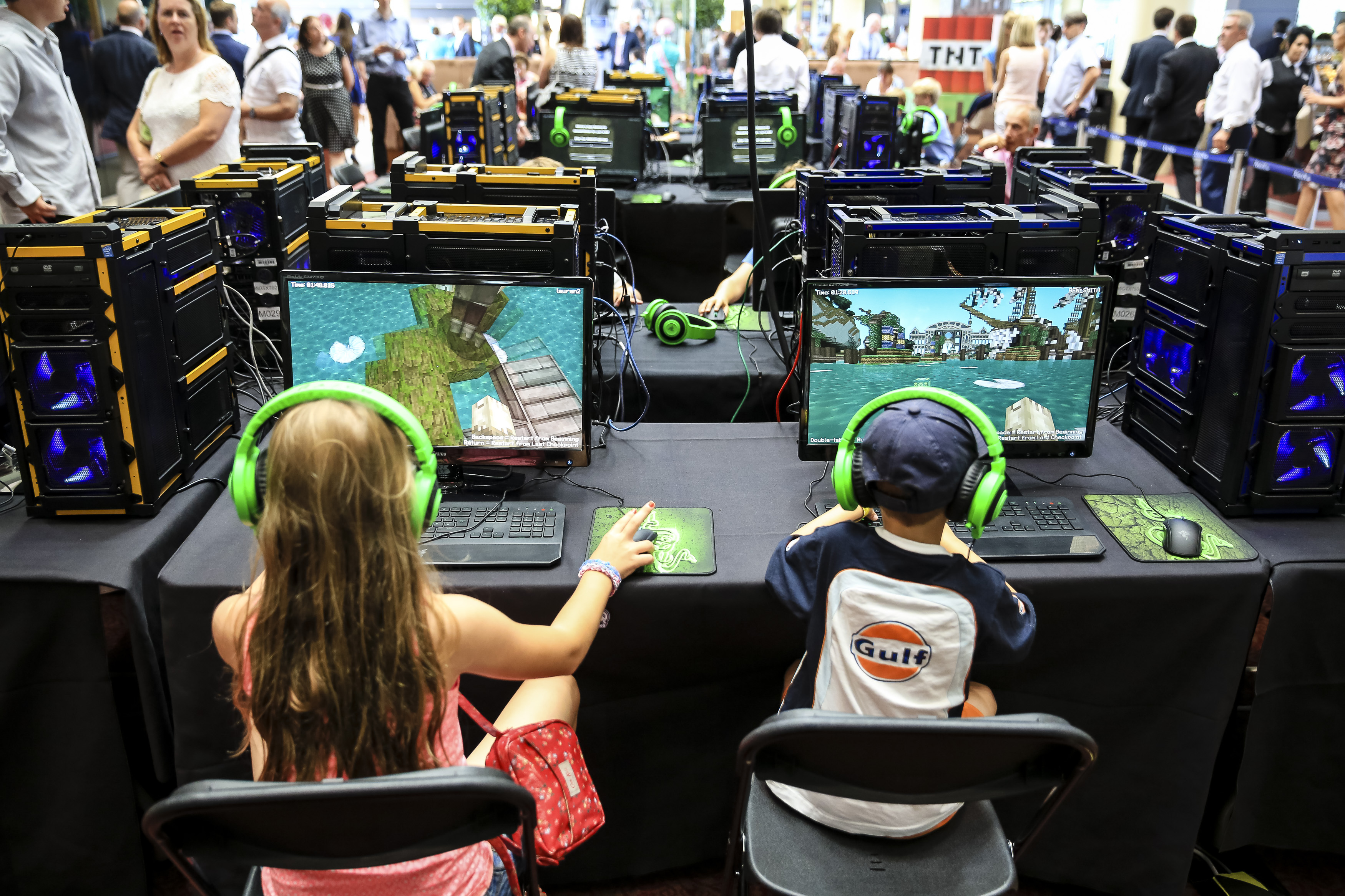 Young racegoers play in a Minecraft tournament during Ascot Dubai Duty Free Shergar Cup and Concert at Ascot Racecourse on August 9, 2014 in Ascot, England.