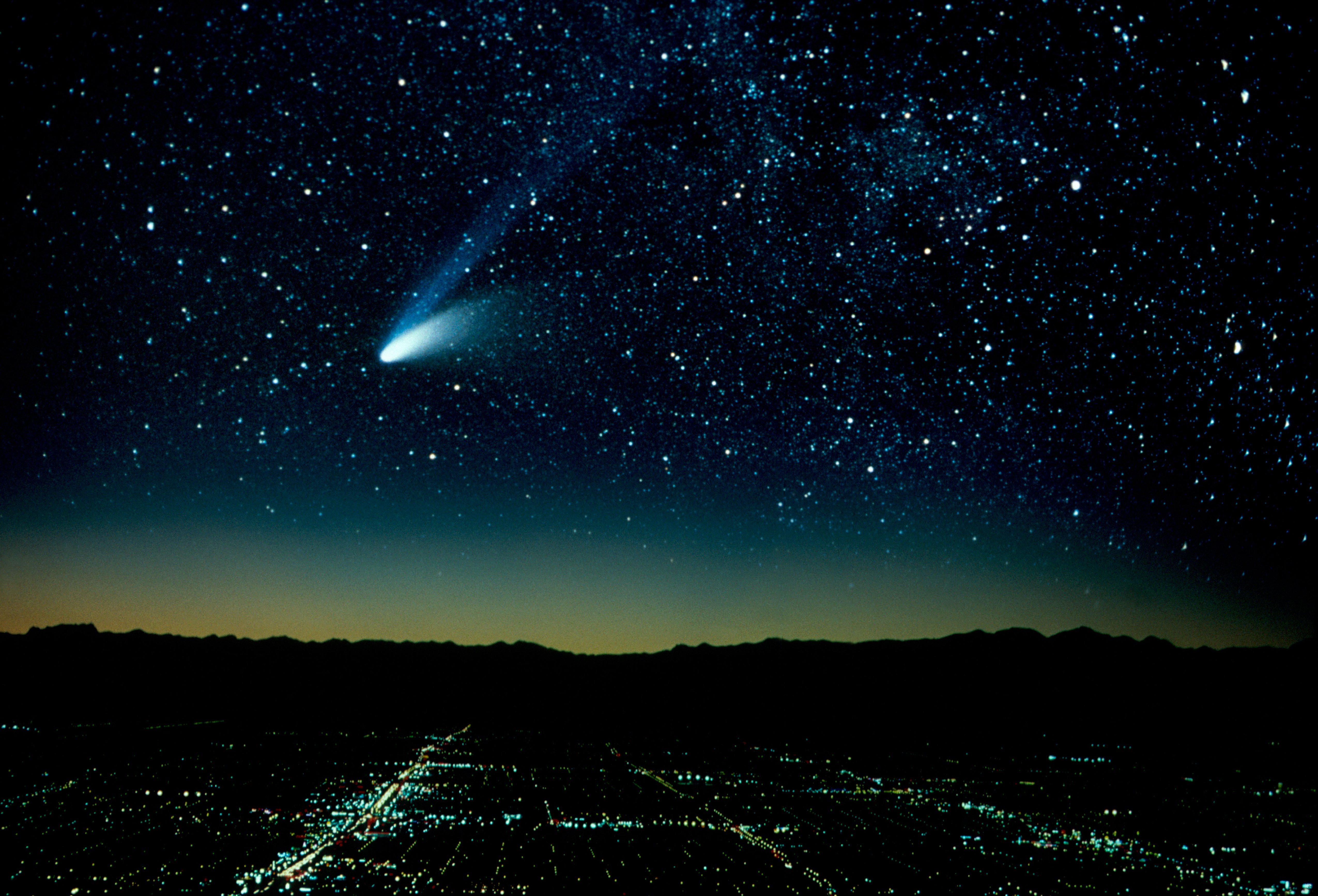 Hale-Bopp Comet And City At Night (Composite).