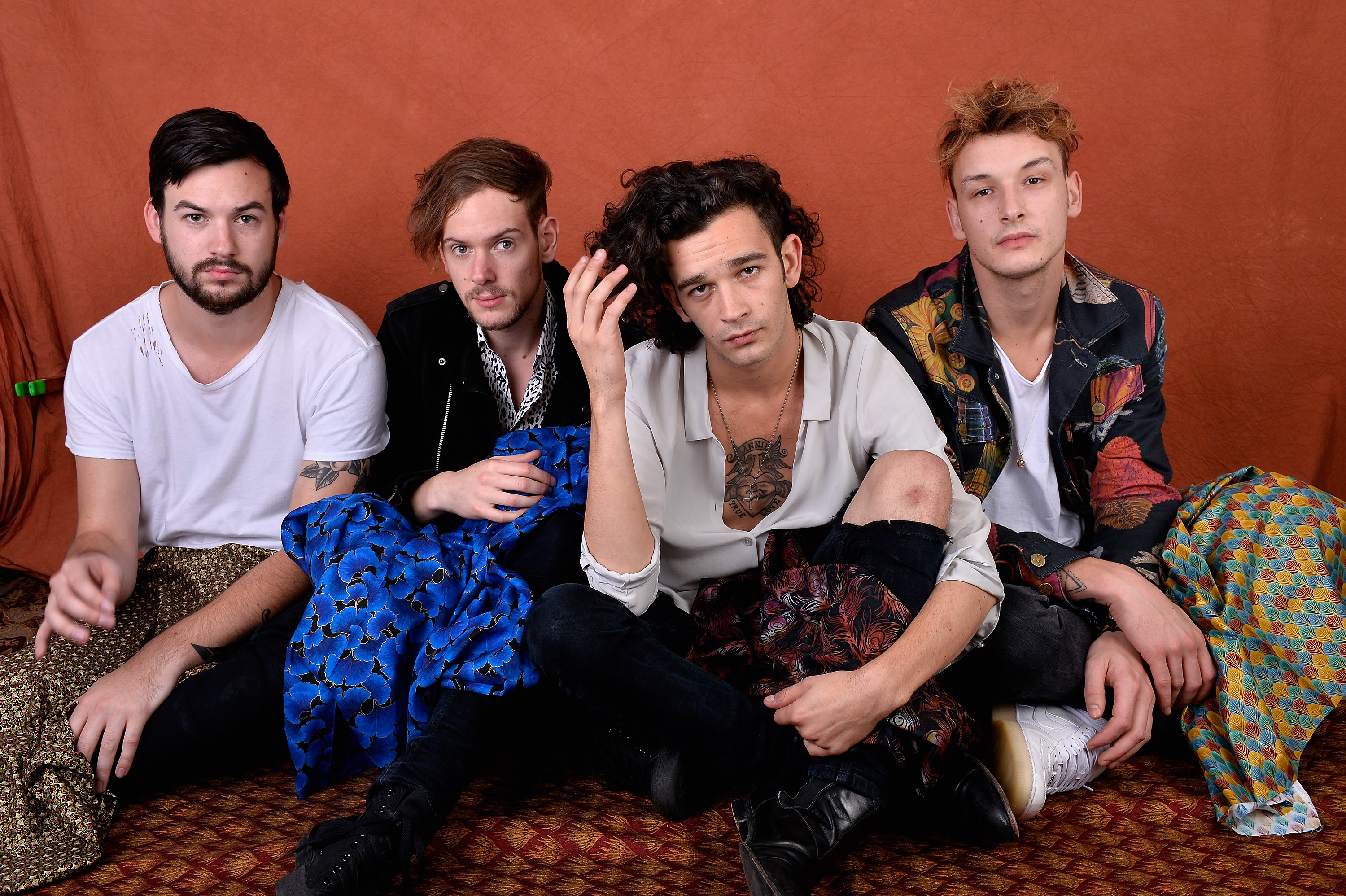 The 1975 band members, George Daniel, Adam Hann, Matthew Healy and Ross MacDonald, pose for a portrait during the the 2014 Boston Calling Music Festival on Sept. 7, 2014, in Boston