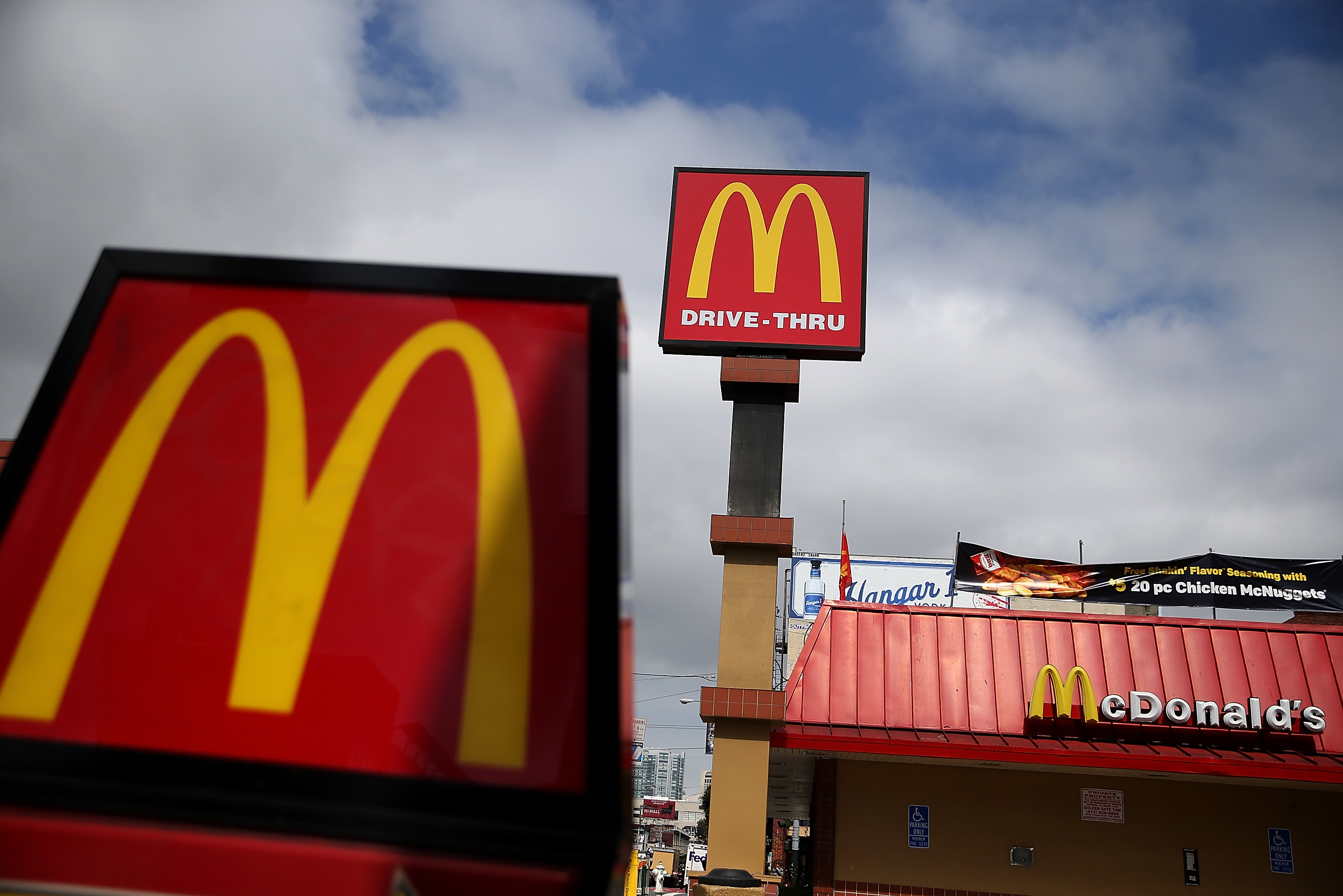 Signs are posted on the exterior of a McDonald's restaurant on April 22, 2015 in San Francisco, Calif.
