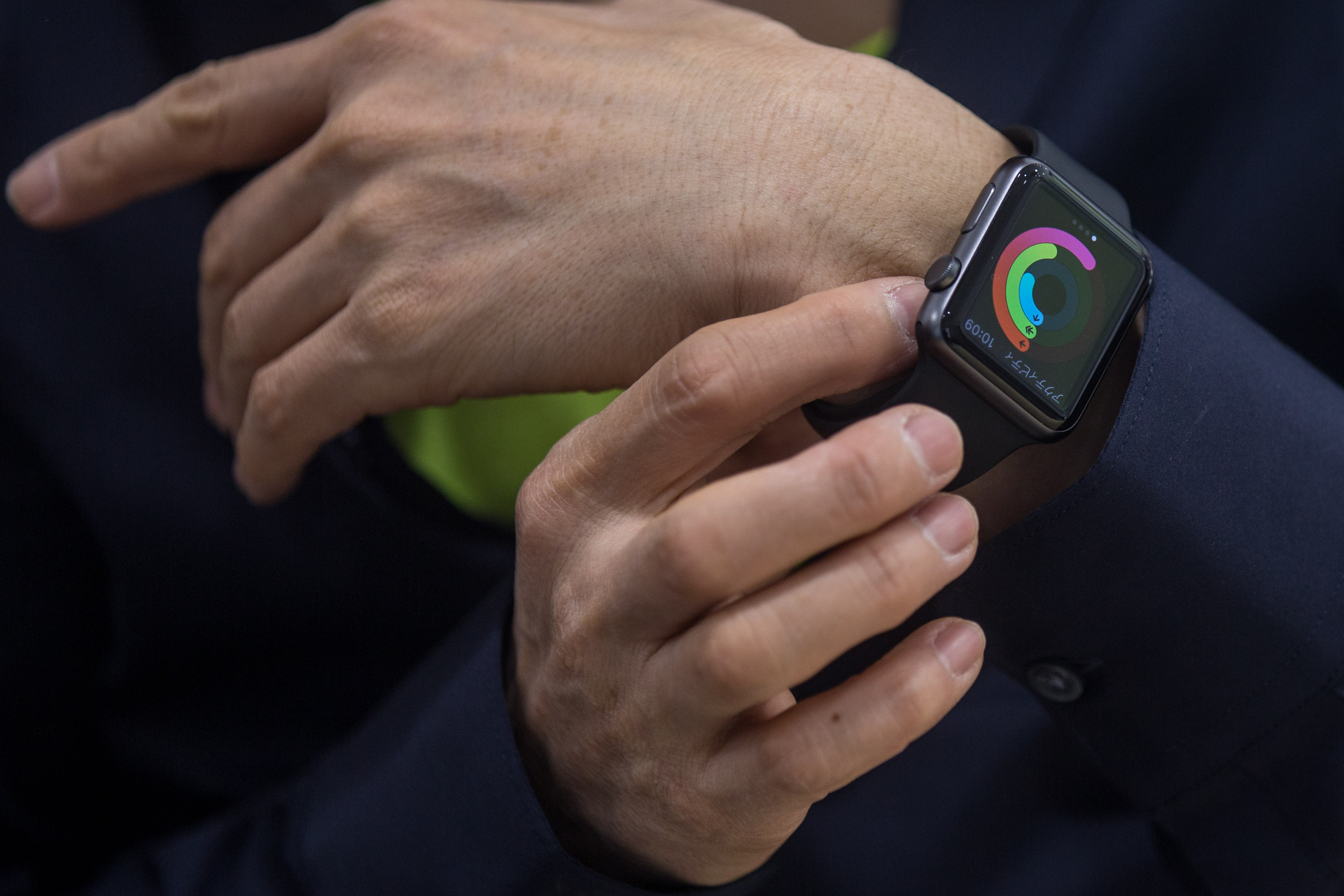 A customer tries on an Apple Watch at a store on April 24, 2015 in Tokyo, Japan.