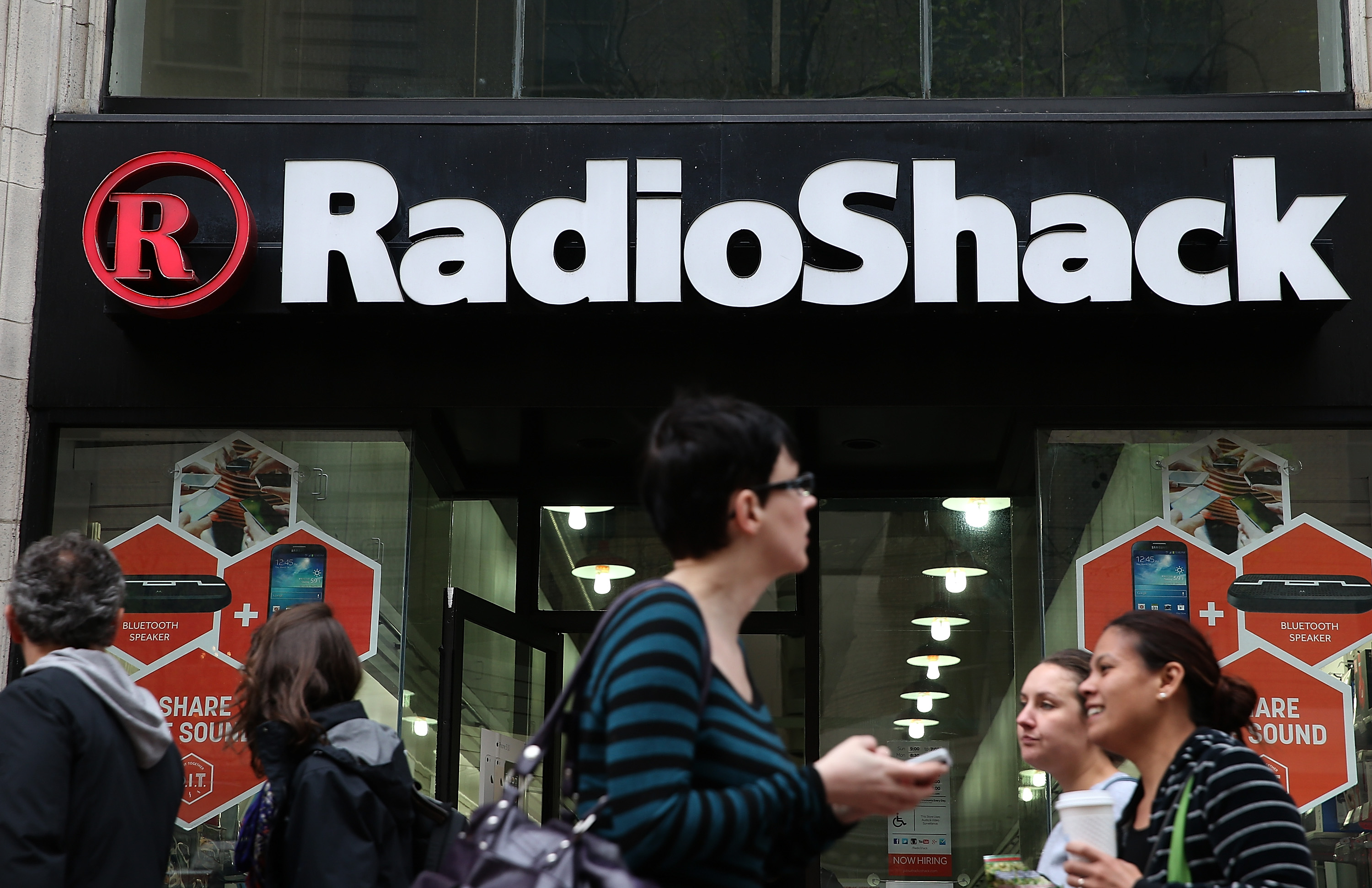 People walk by a Radio Shack store on March 4, 2014 in San Francisco, California.
