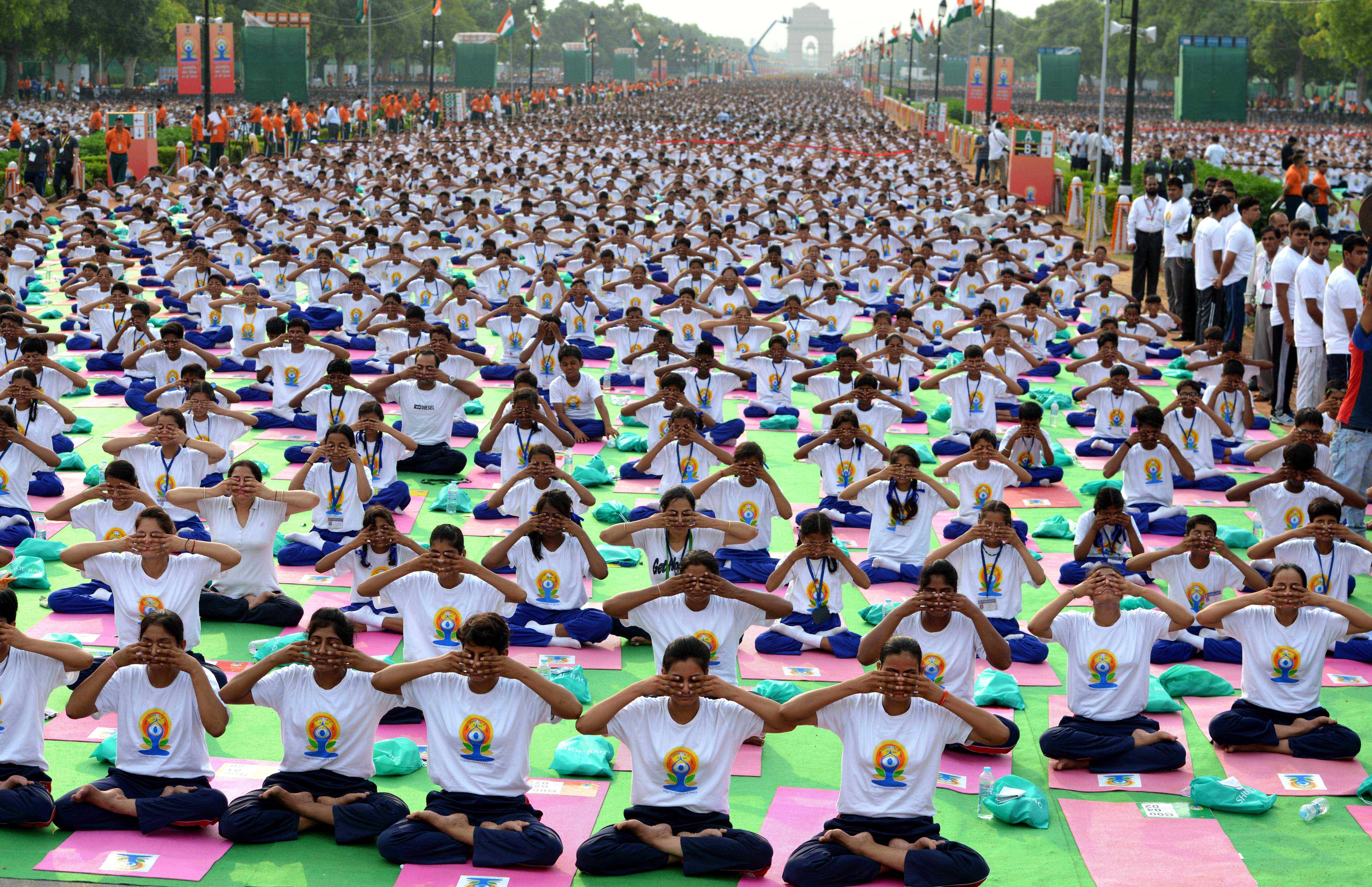 Thousands gather for a mass yoga session to mark International Yoga Day on June 21, 2015, at Rajpath in New Delhi