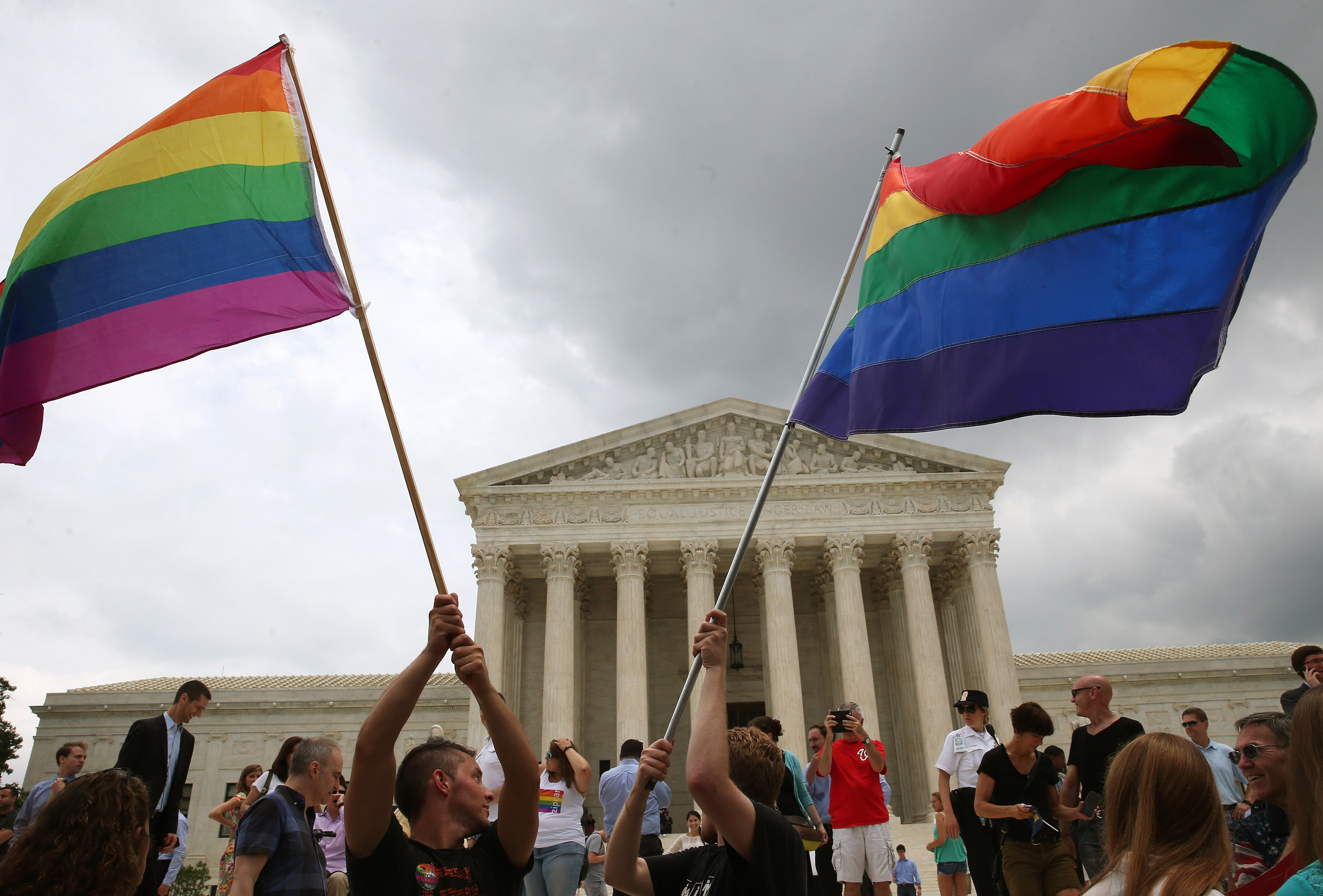 People celebrate in front of the U.S. Supreme Court after the ruling in favor of same-sex marriage June 26, 2015 in Washington, DC. The high court ruled that same-sex couples have the right to marry in all 50 states.  (Photo by Mark Wilson/Getty Images)
