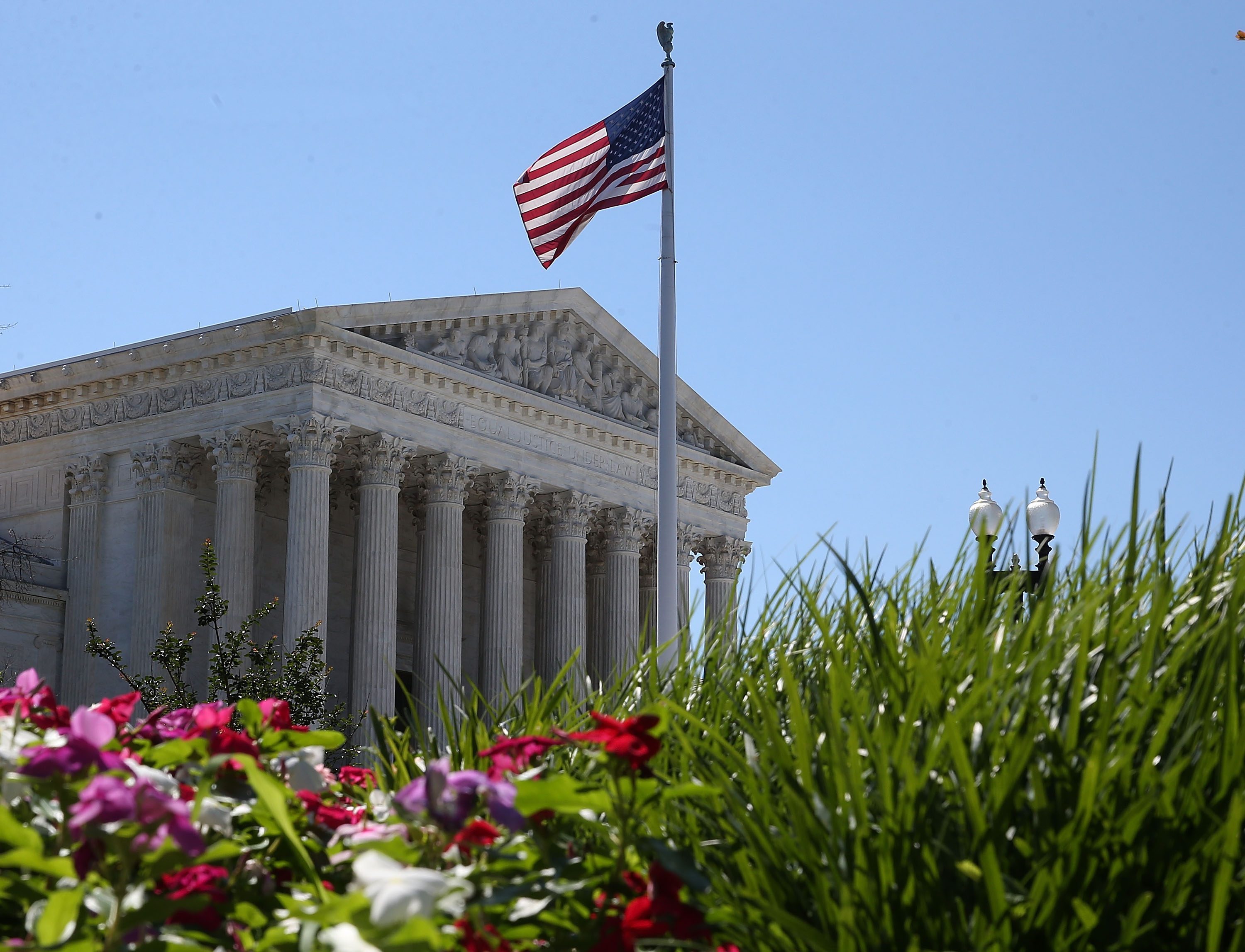 An American flag flies over the U.S. Supreme Court June 29, 2015 in Washington, DC.  ( Mark Wilson/Getty Images)
