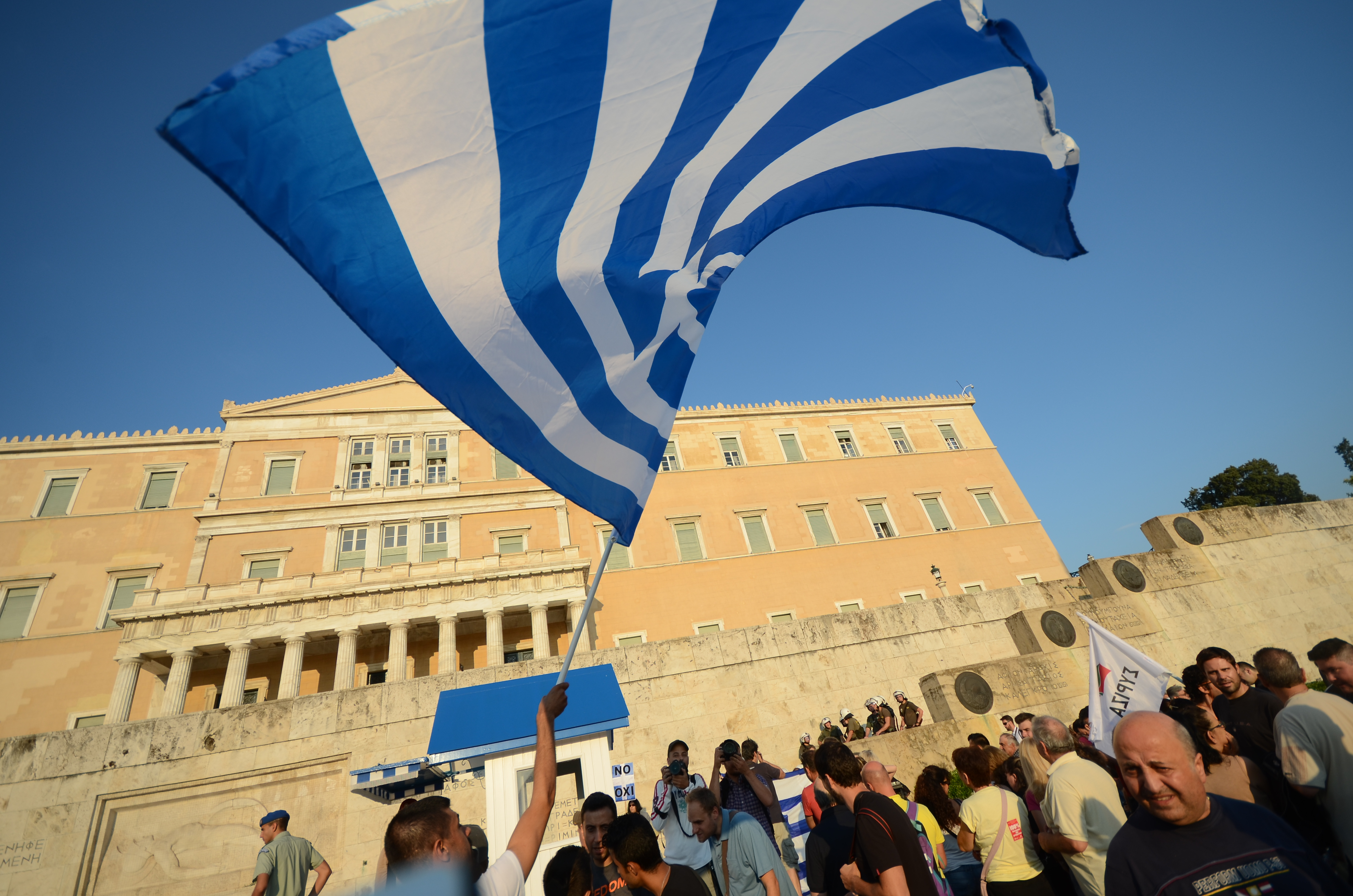 People waving flags at Syntagma square.  (George Panagakis--Pacific Press/LightRocket via Getty Images)