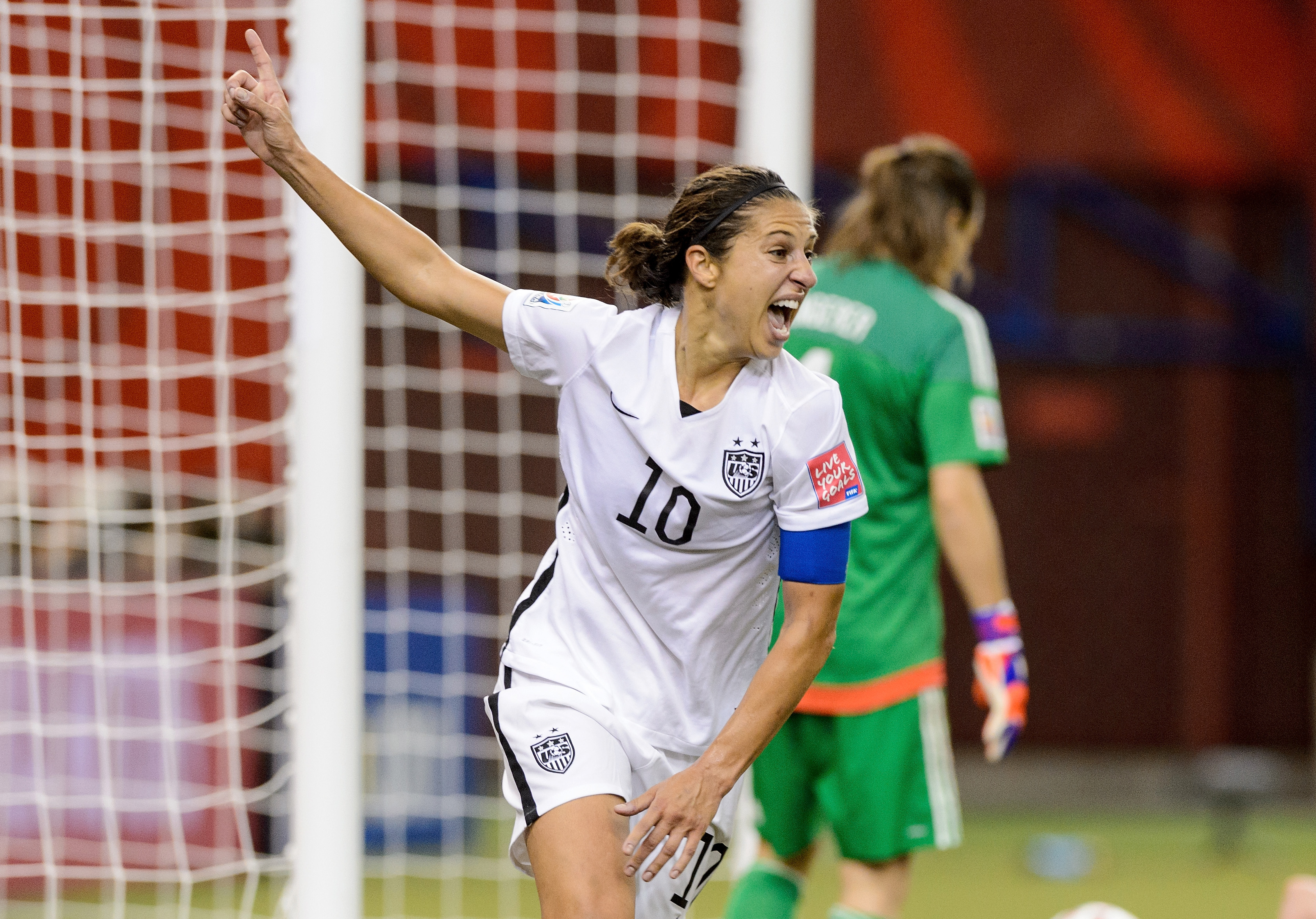 Carli Lloyd celebrates setting up Kelly O'Hara's goal in the FIFA Women's World Cup 2015 Semi-Final Match at Olympic Stadium on June 30, 2015 in Montreal, Canada.