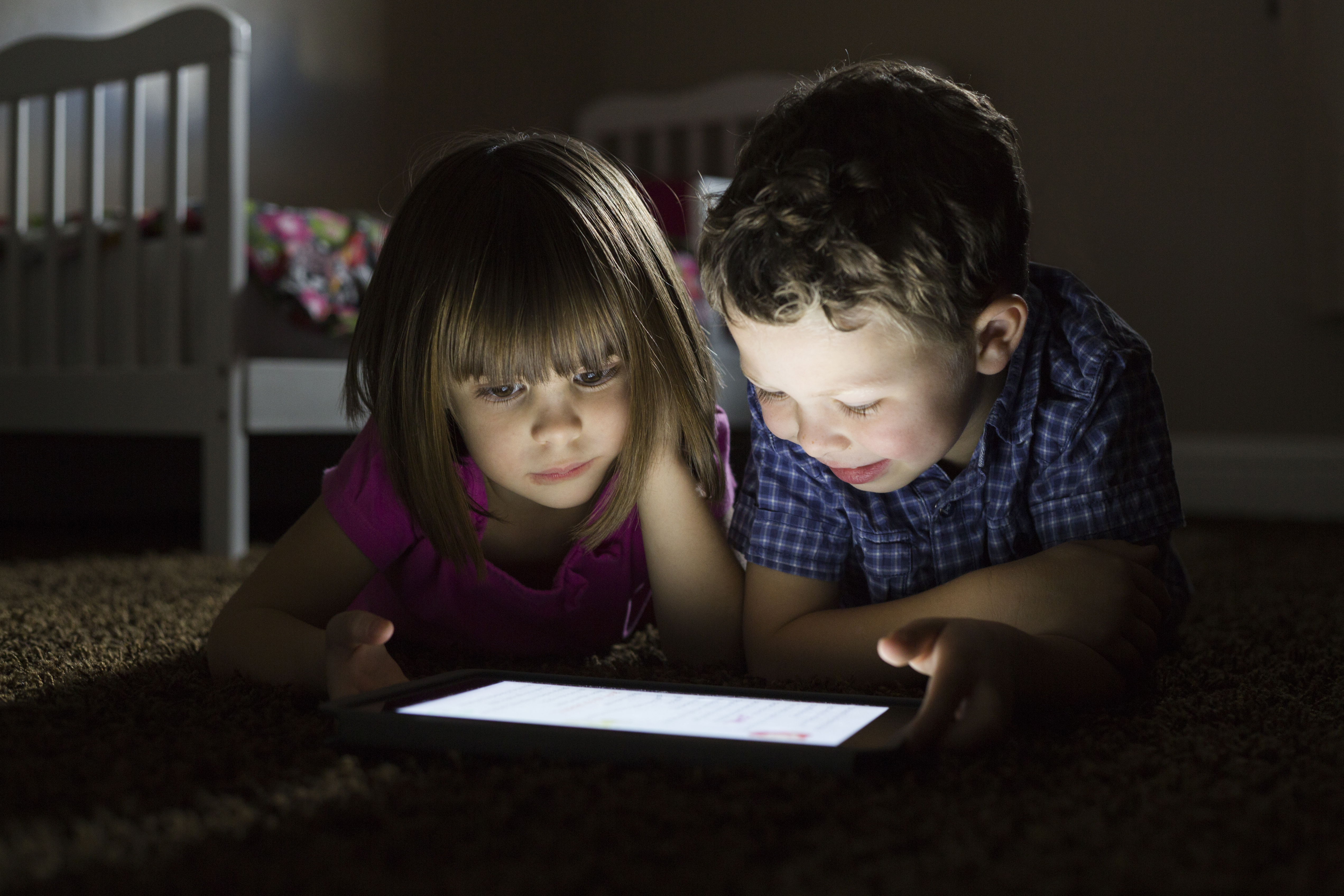 Children using a tablet.