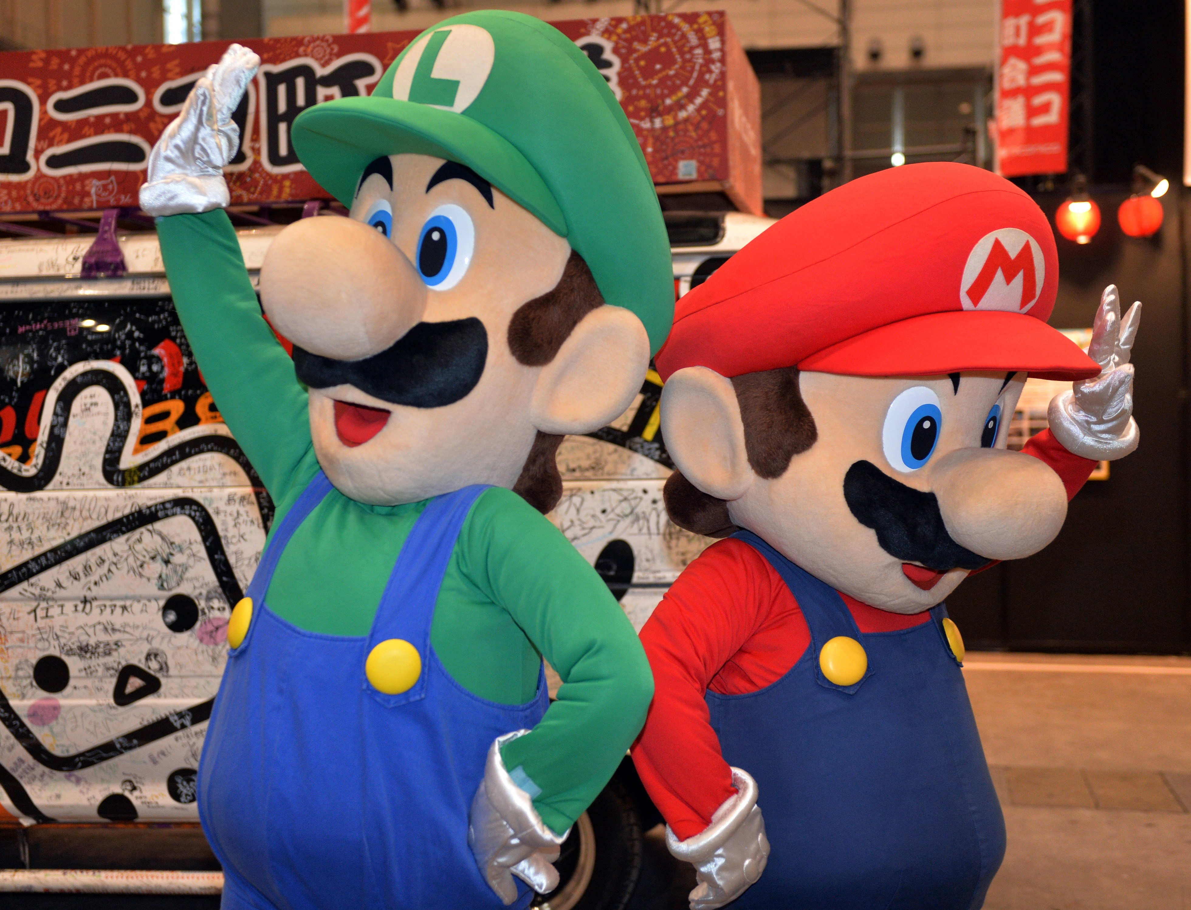 This picture taken on April 26, 2014 shows Japanese videogame giant Nintendo's characters Super Mario and Luigi (L) performing in Chiba, suburban Tokyo.