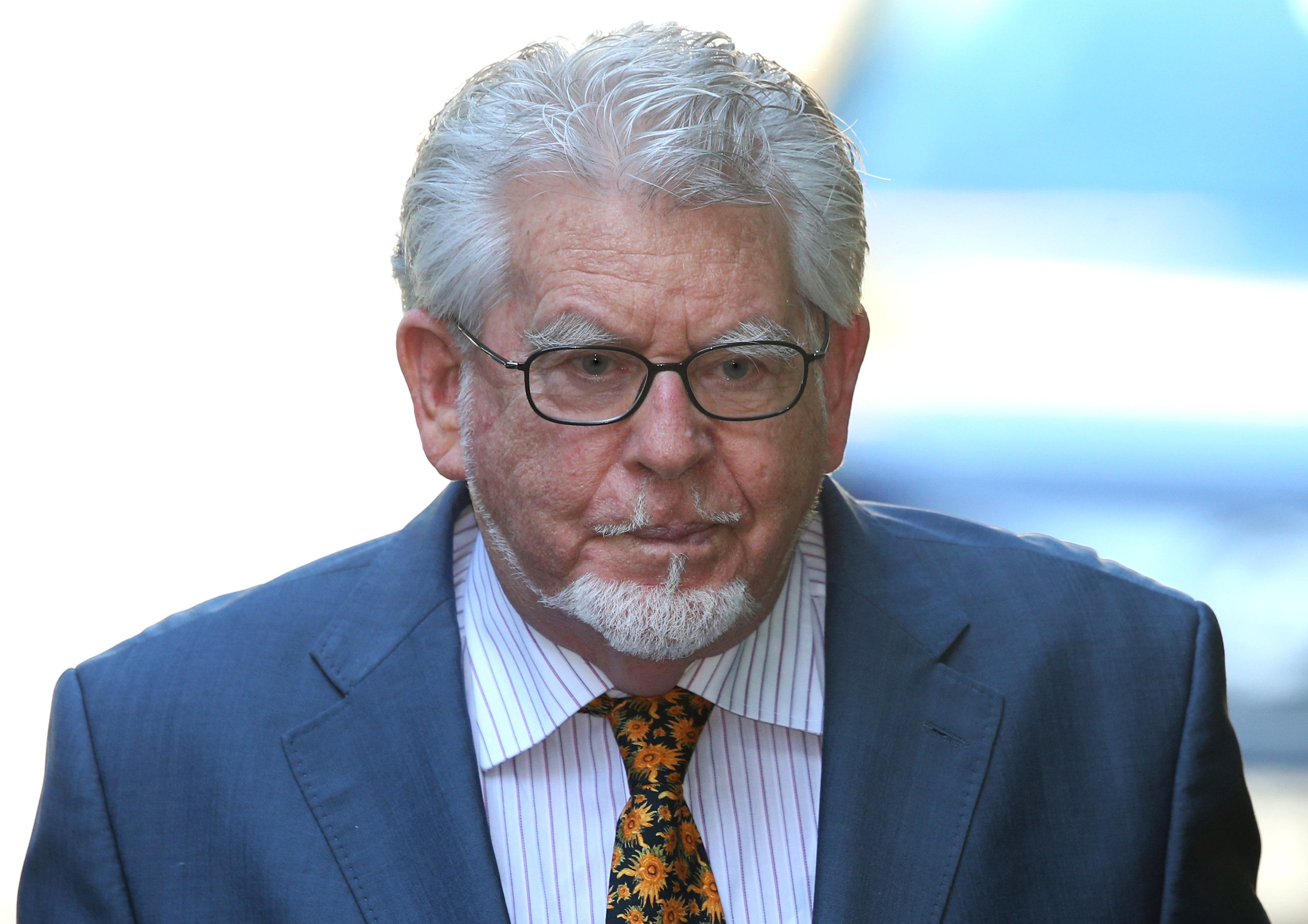 Artist and television personality Rolf Harris arrives at Southwark Crown Court in London on May 14, 2014