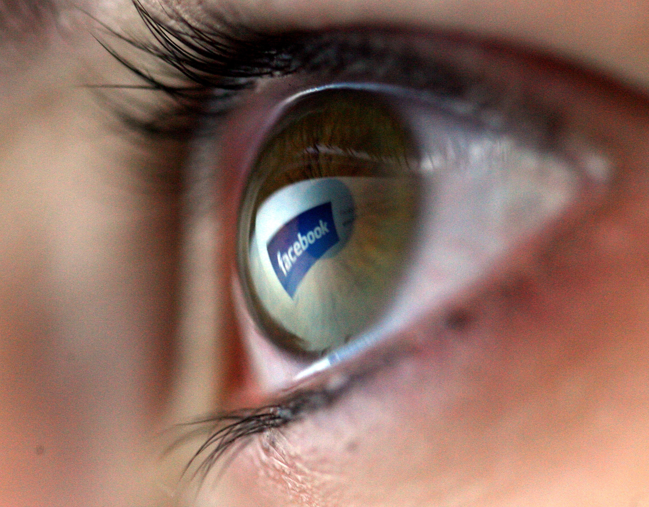 Facebook logo is reflected in the eye of a girl on February 3, 2008 in London, England.
