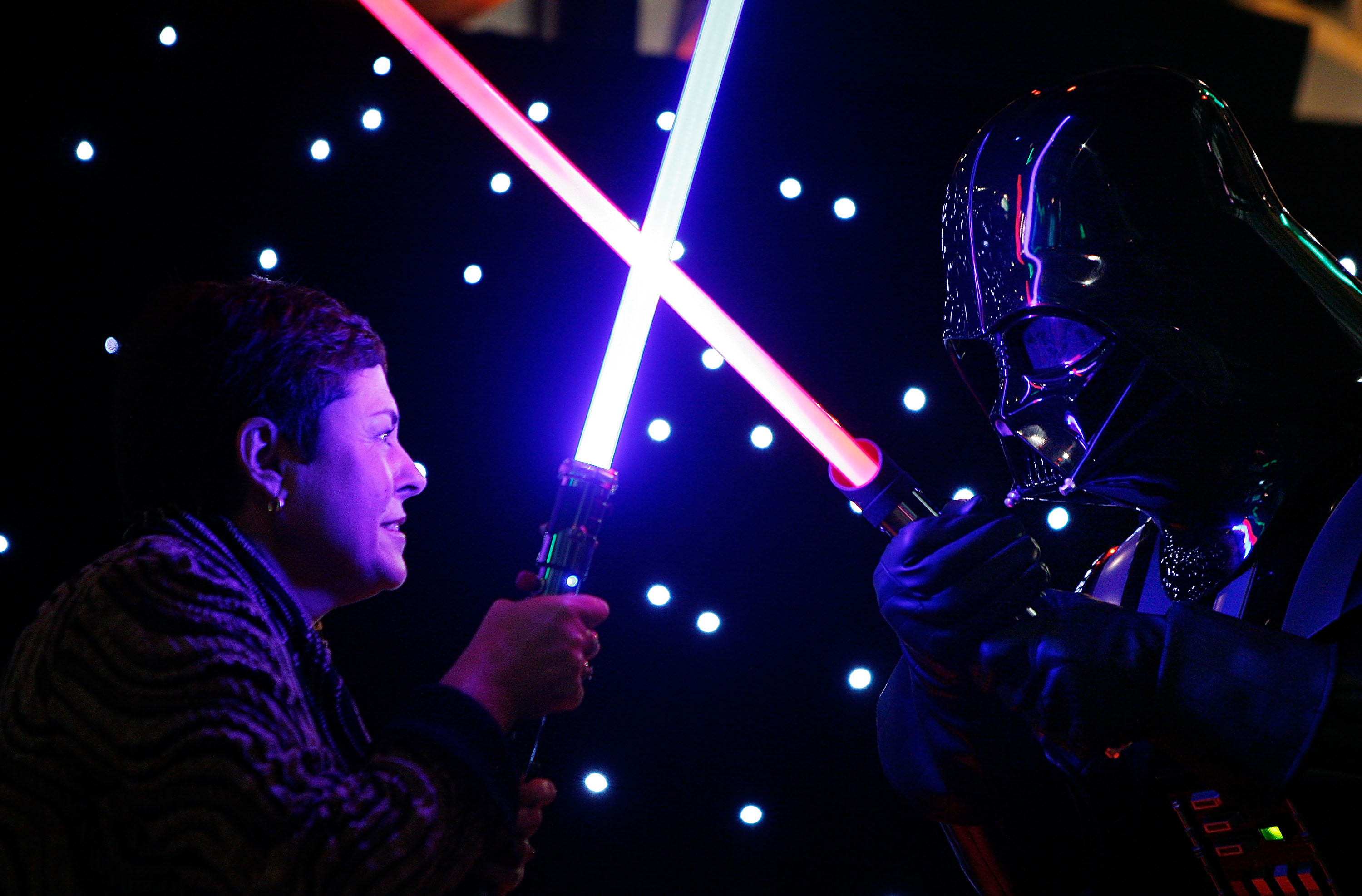 Lynne Kosky (L), Victoria's Minister for Public Transport and Minister for the Arts has a lightsaber battle with an actor dressed as Darth Vader during a preview to the 'Star Wars: Where Science Meets Imagination' exhibition at Scienceworks on June 2, 2009 in Melbourne, Australia.