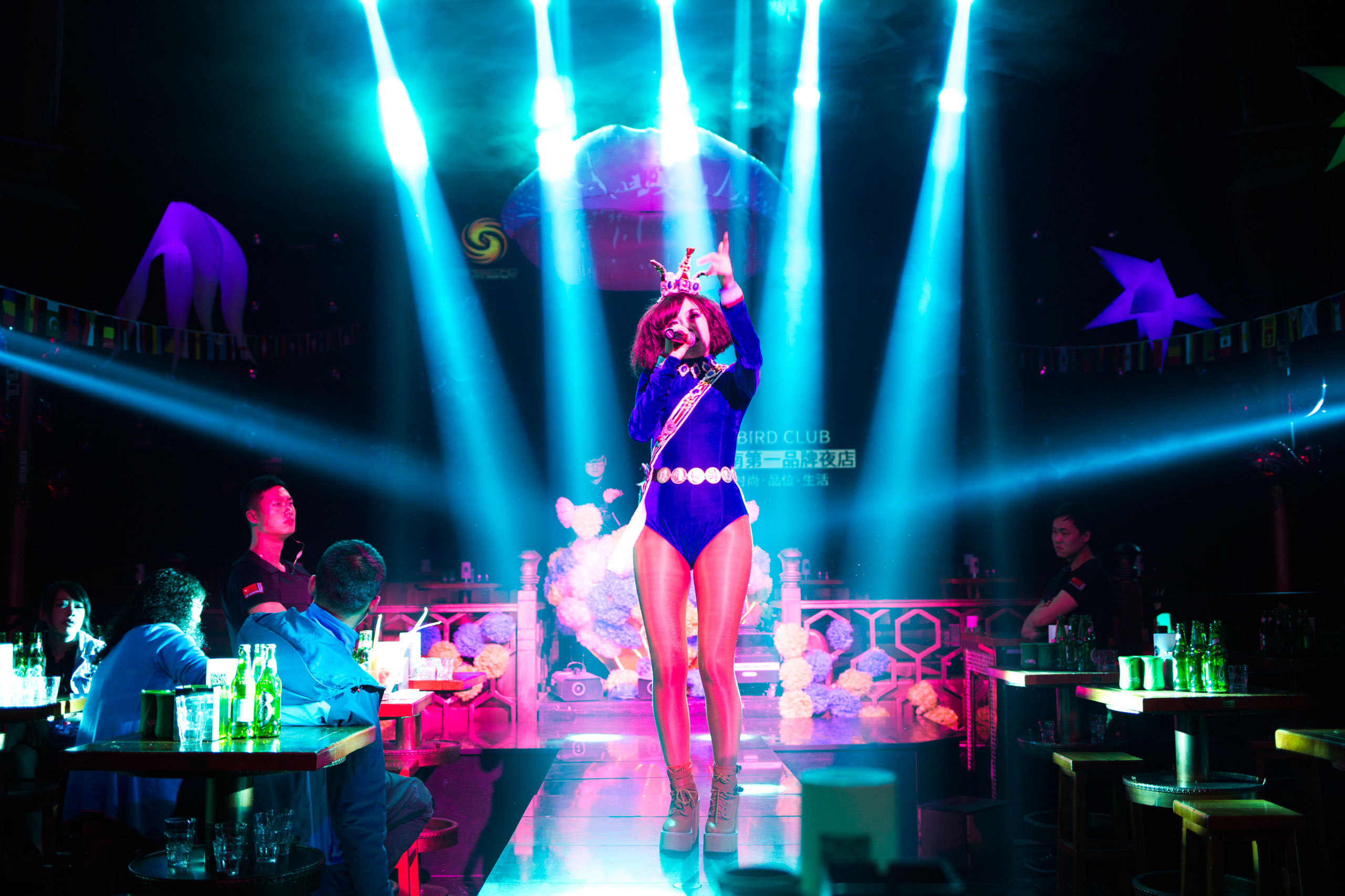 A singer performs in a night club in Kunming, China's southern Yunnan province, Feb. 22, 2015. Club owners there often hire singers and dancers to entertain the customers.