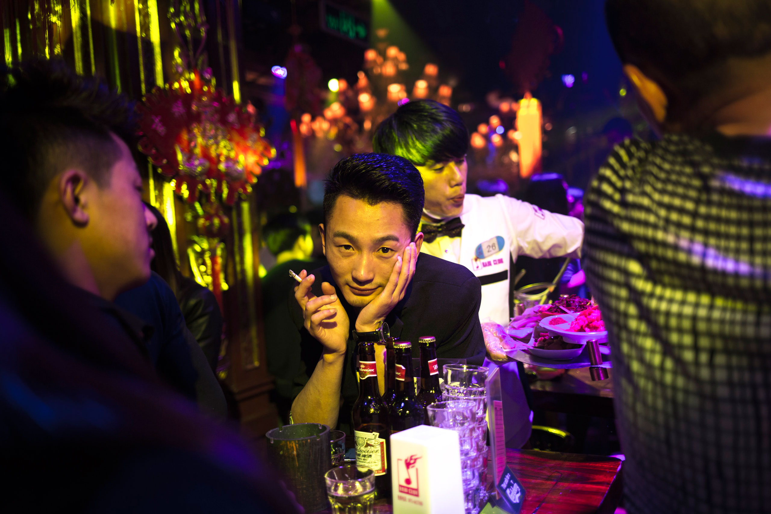 Patrons at a night club in Kundu, where most clubs are located in Kunming, Yunnan Province, China, Feb. 28, 2015.
