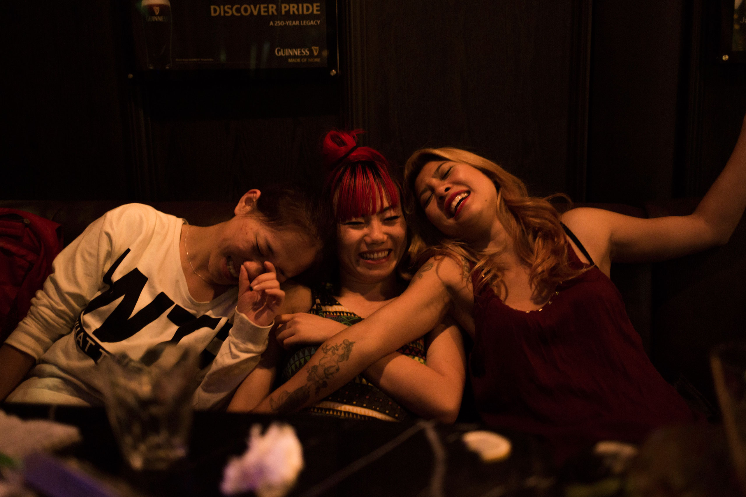 From left to right, Winne, Phoenix and Nana hang out after teaching a dance course, March 23, 2015.
