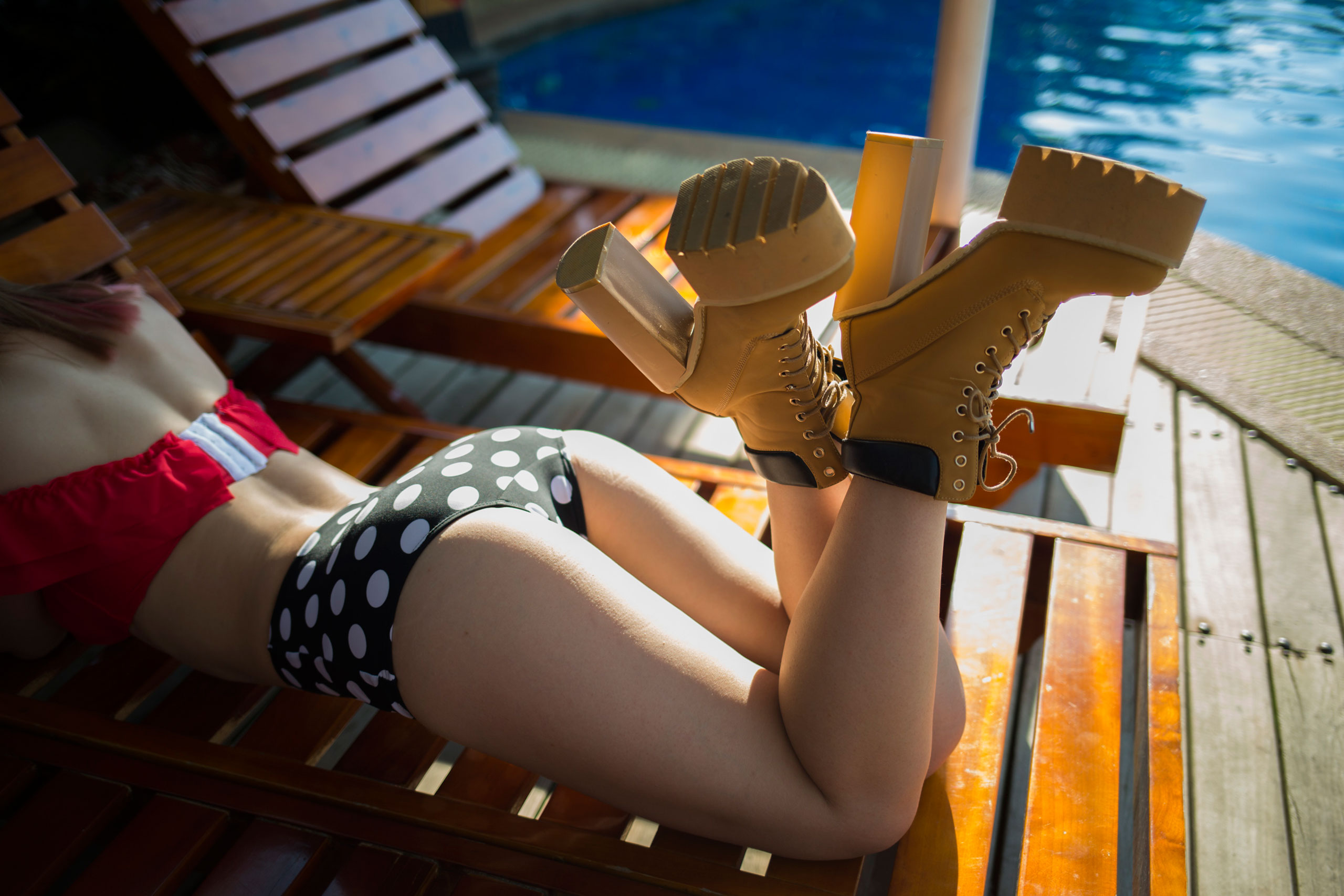 Fangzhou, a member of Dangsters, takes a break during a commercial video shoot at poolside, March 13, 2015.