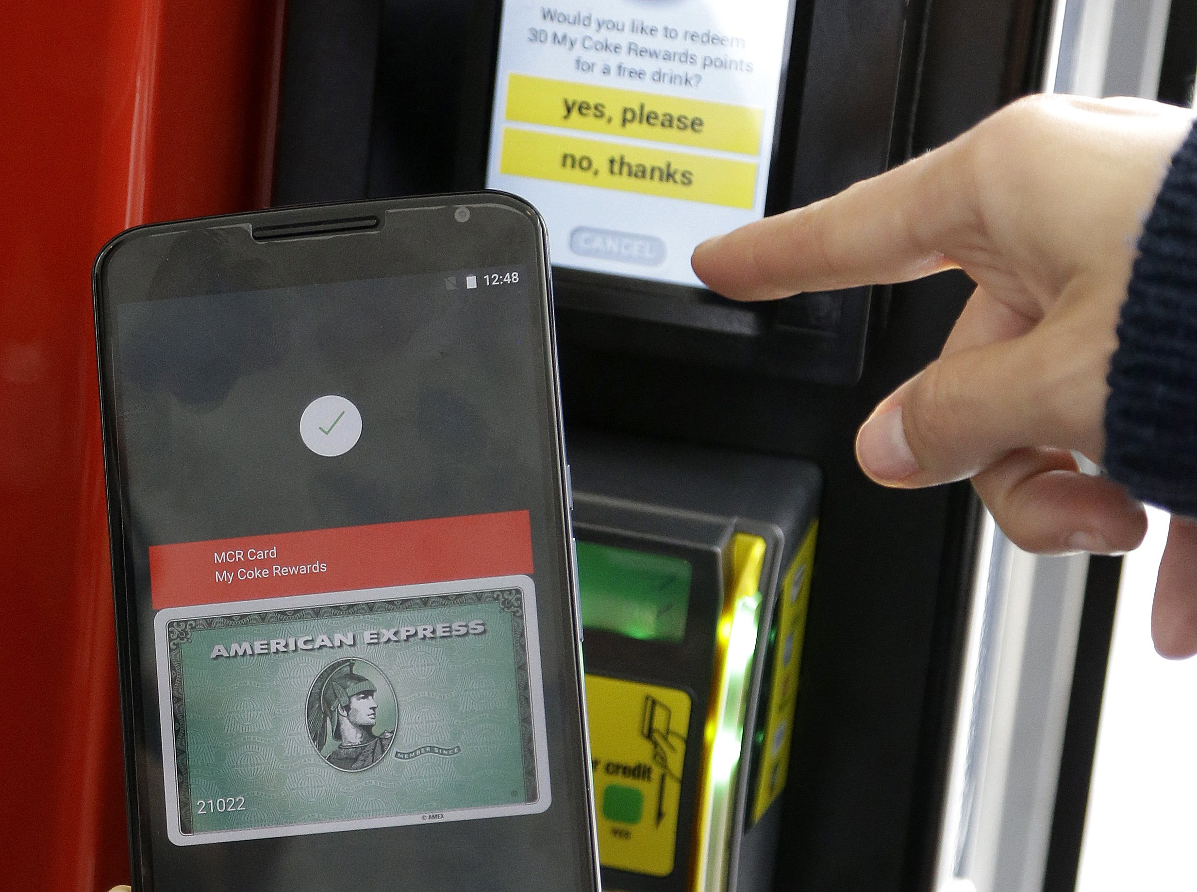 Google's Android Pay will be on the next version of Google's Android operating system, and it will boast new ways to fetch information, pay merchants and protect privacy on mobile devices as the Internet company duels with Apple in the quest to make their technology indispensable.