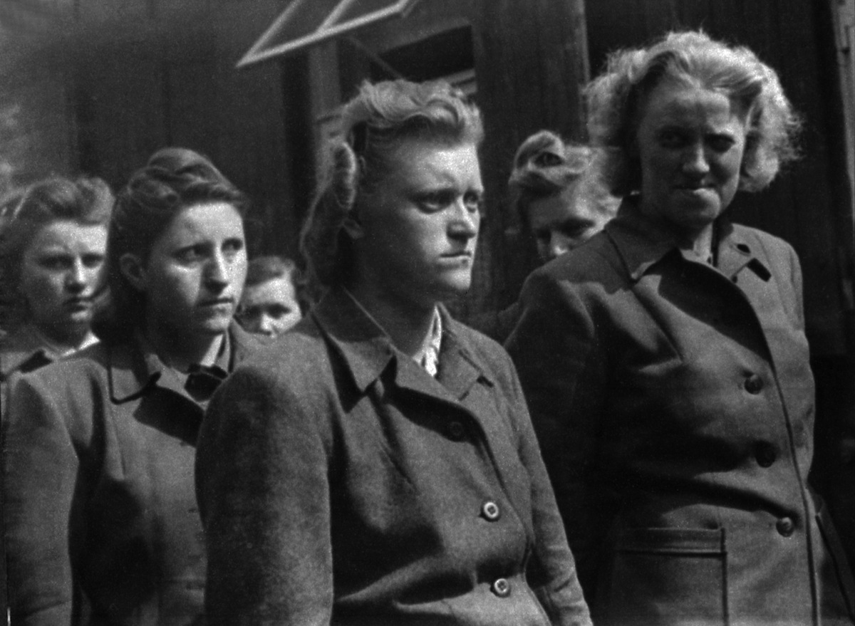 Women guards of the Bergen-Belsen Nazi concentration camp, including Herta Bothe (right) and Irma Grese (second right) are seen after capture by British troops who liberated the camp, April 1945.