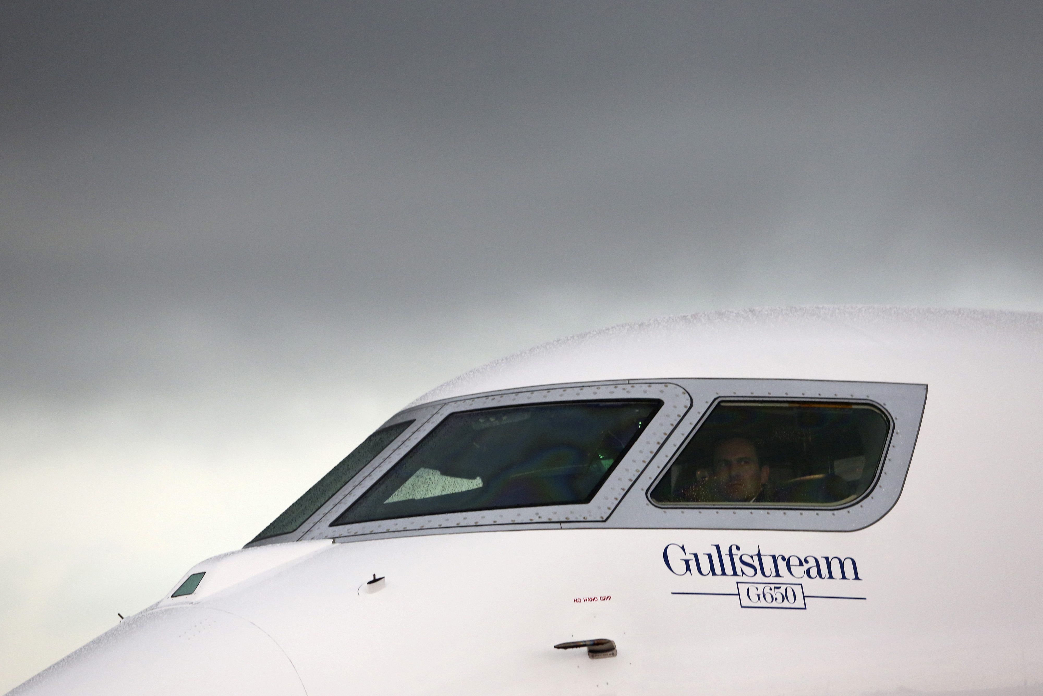 A logo sits beneath the cockpit window of a Gulfstream G650 business jet, manufactured by General Dynamics Corp., on the first day of the Paris Air Show in Paris on June 17, 2013.