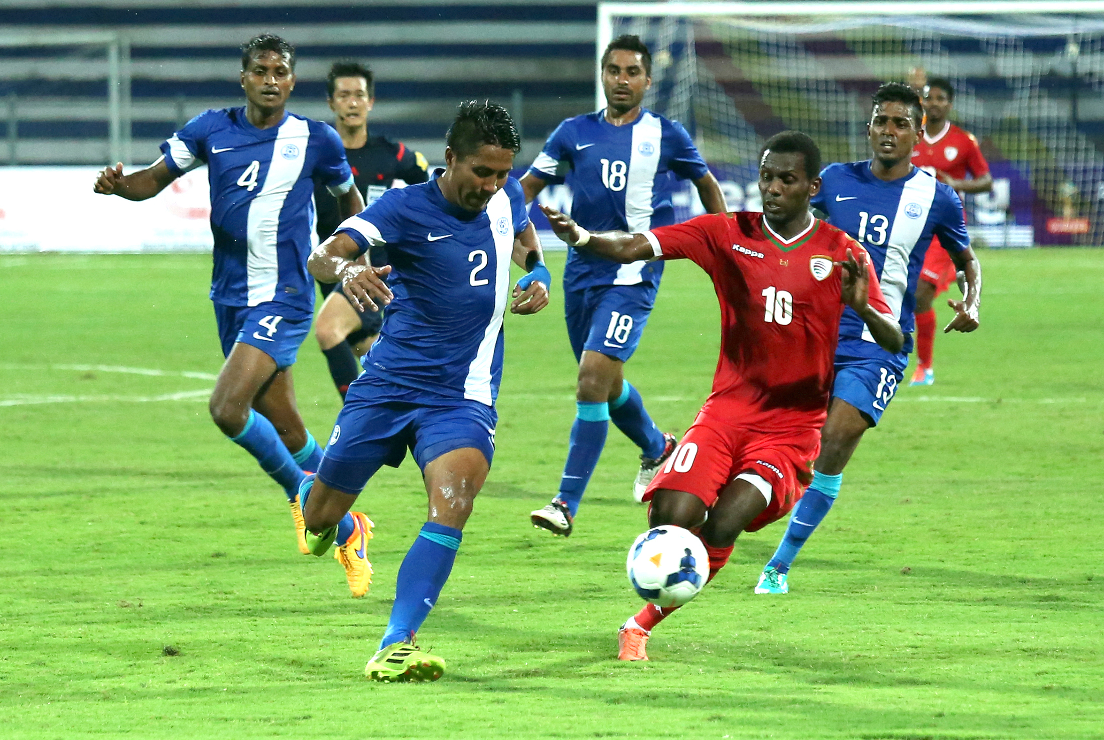 Indian football player Leihaorungbam Dhanachandra singh (L) and Oman football player Qasim said ( R) in action, during a World Cup Qualifier match against India, in Bangalore, India 11 June 2015.
