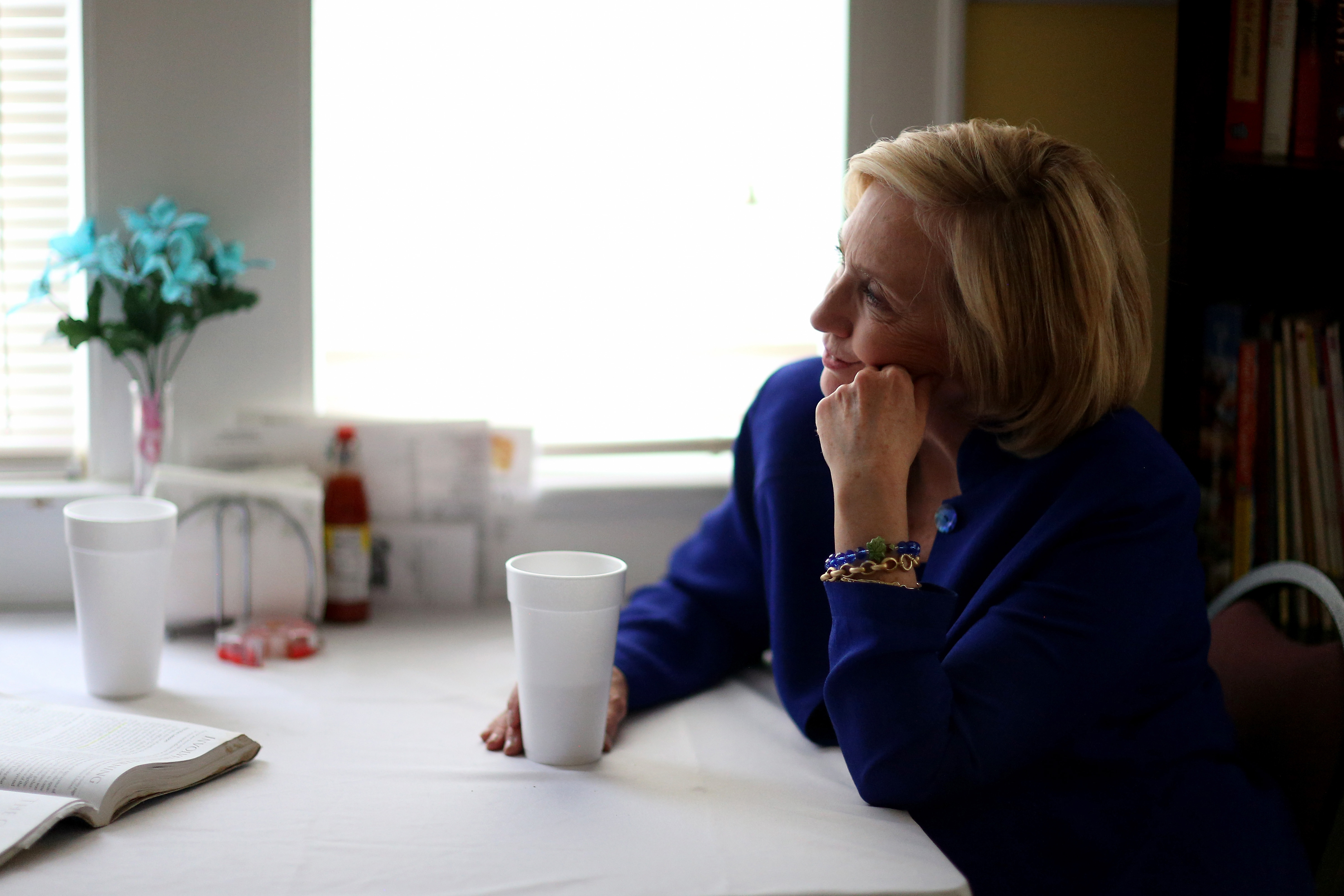 Democratic Presidential candidate Hillary Clinton sits with a customer as she visits the Main Street Bakery on May 27, 2015 in Columbia, SC.