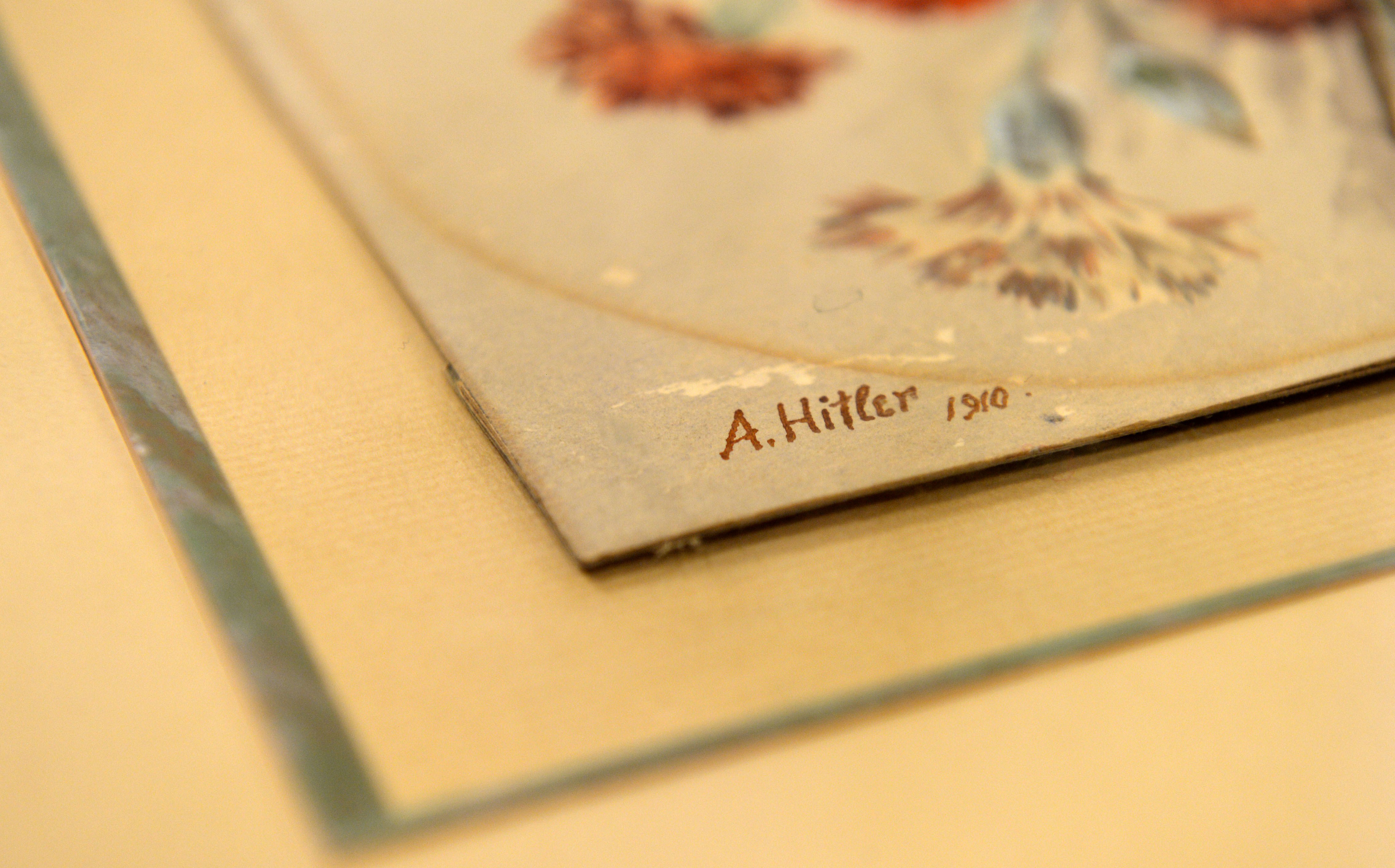 The signature reading 'A Hitler, 1910' at the watercolor  Nelkenstrauss  (carnation bouquet) is pictured, on June 11, 2015 in the Weidler auction house in Nuremberg, southern Germany.