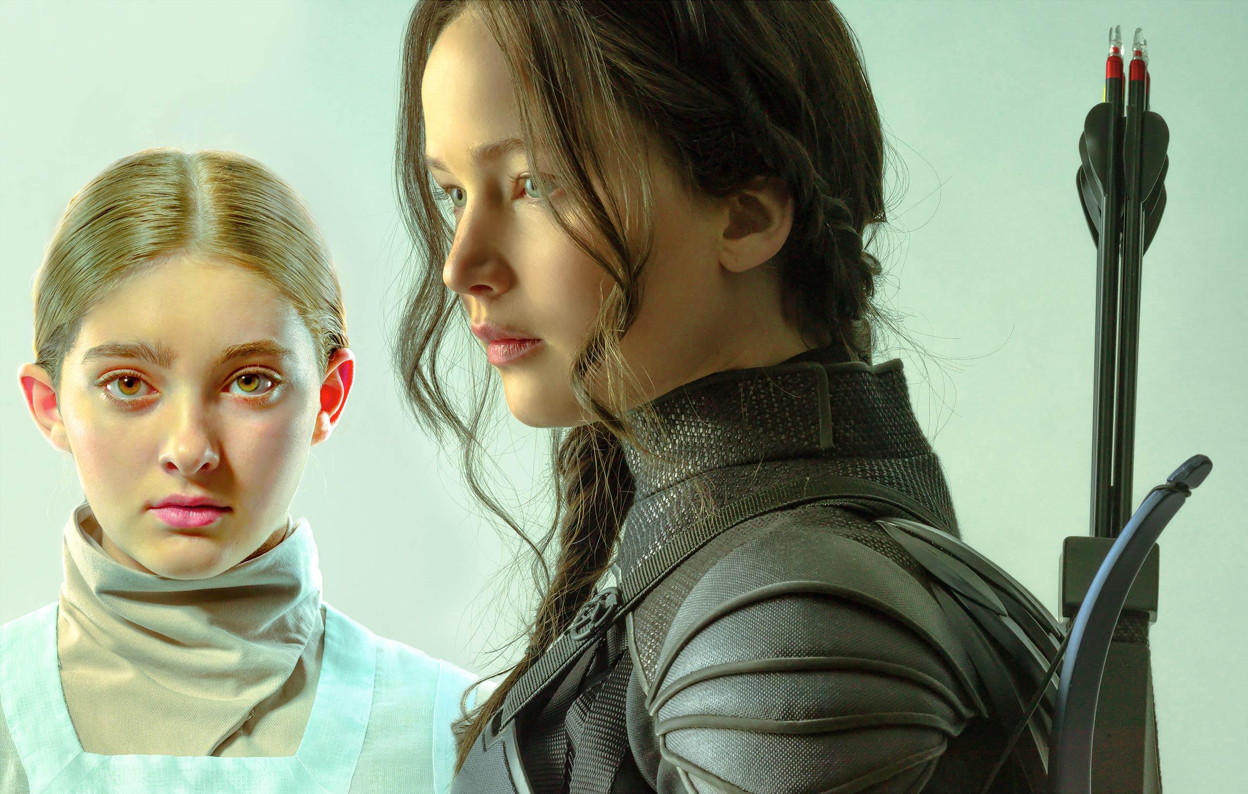 Willow Shields as Primrose Everdeen and Jennifer Lawrence as Katniss Everdeen