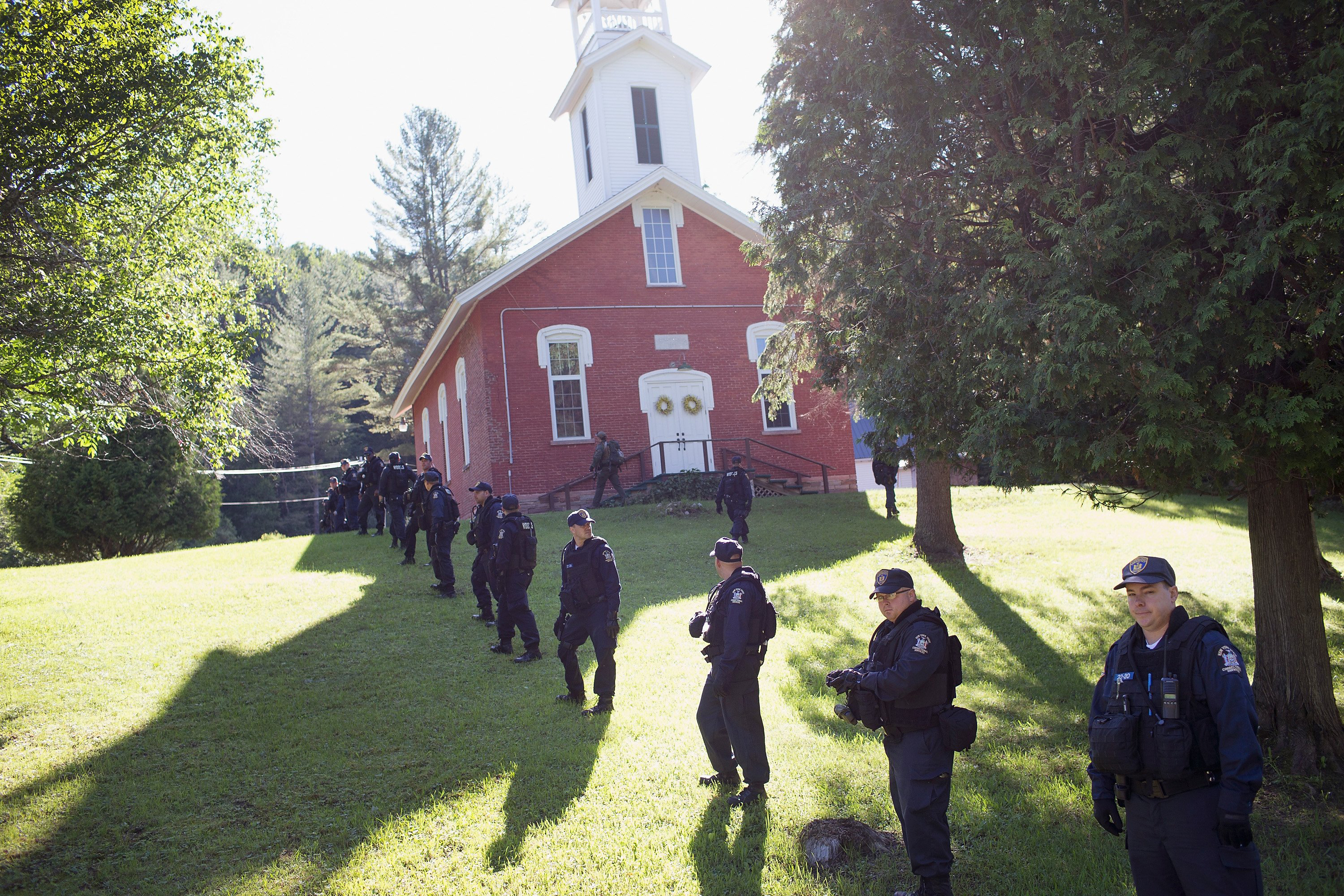 Law enforcement personnel prepare to head out on a search for convicted murderers Richard Matt and David Sweat on June 26, 2015 in Chasm Falls, New York.