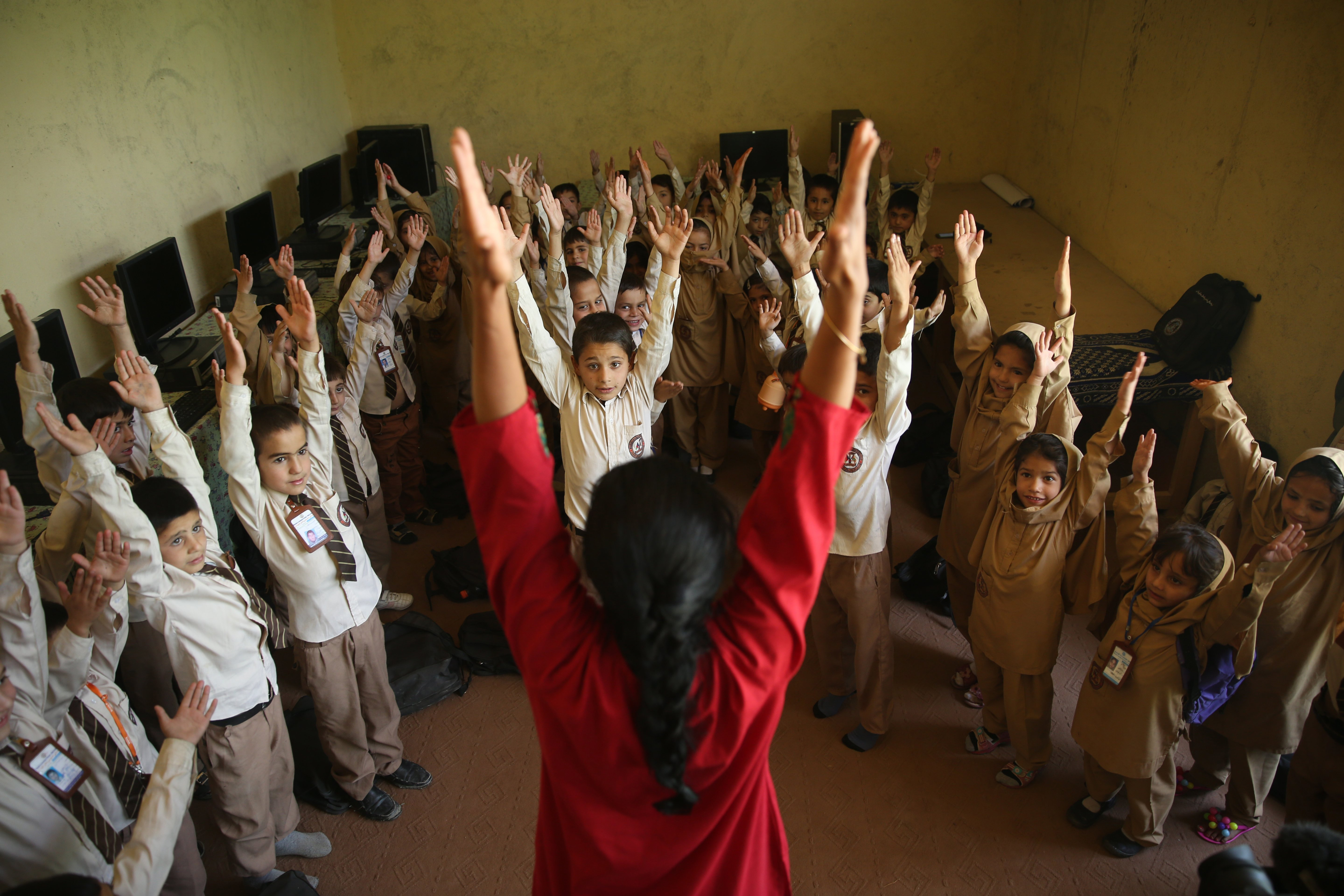 Afghan students perform yoga during the first International Yoga Day, at a private school in Kabul, on June 21, 2015.