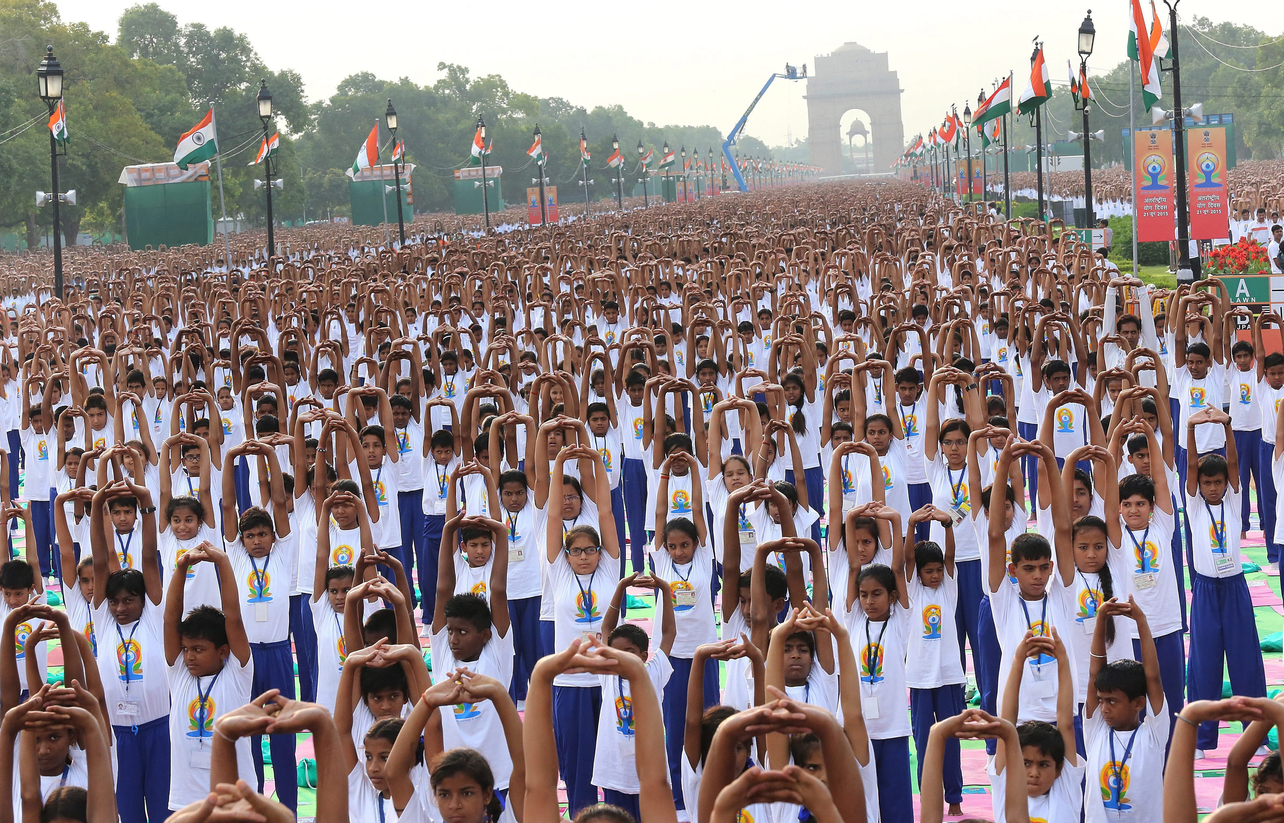 Thousands of participants perform yoga yoga to mark the international Day of Yoga, at Rajpath, a boulevard in New Delhi, on June 21, 2015.